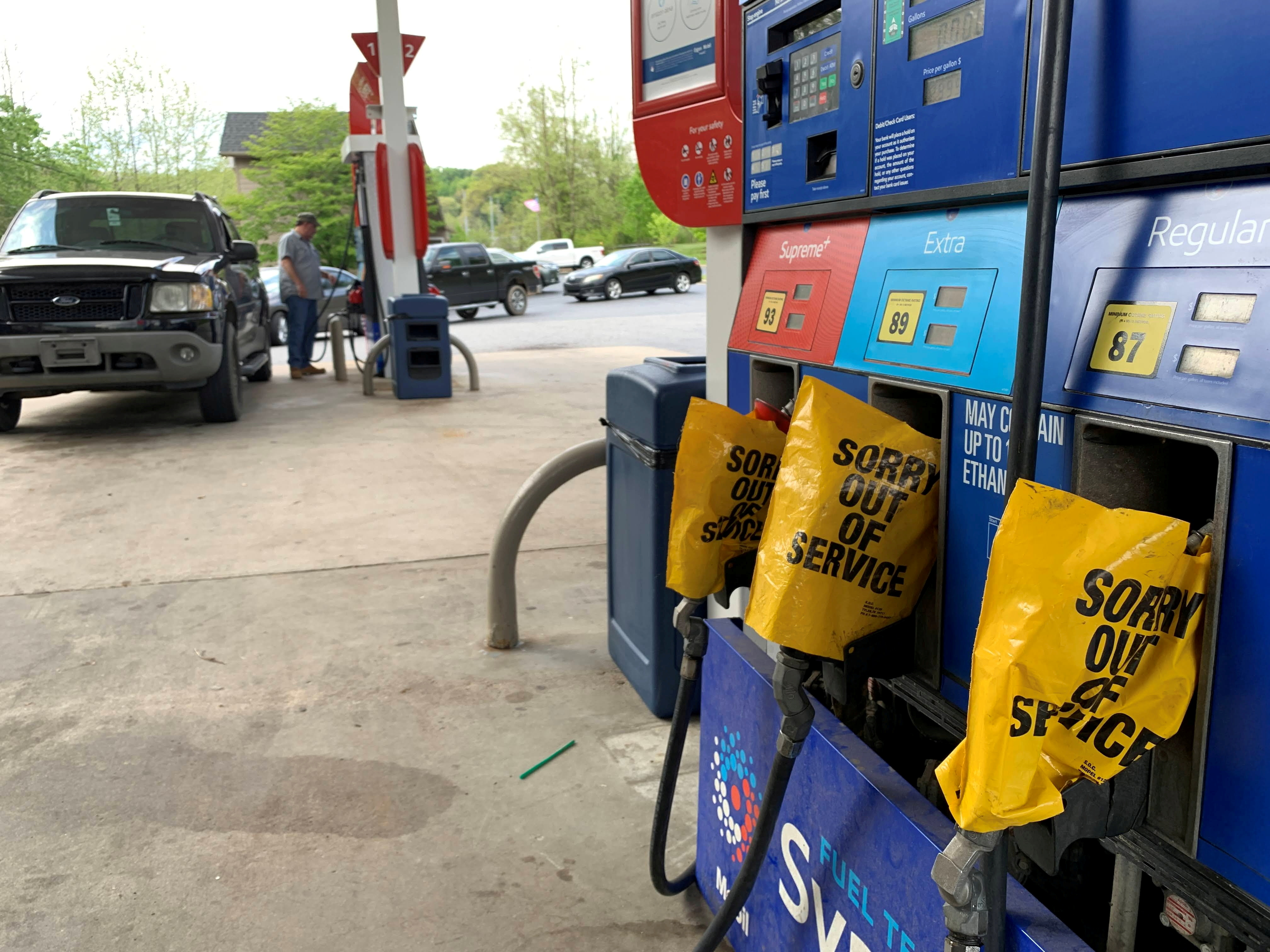Out of service fuel nozzles are covered in plastic on a gas pump at a gas station in Waynesville, North Carolina, after a gasoline supply crunch caused by the Colonial Pipeline hack, May 11, 2021. Martin Brossman via REUTERS