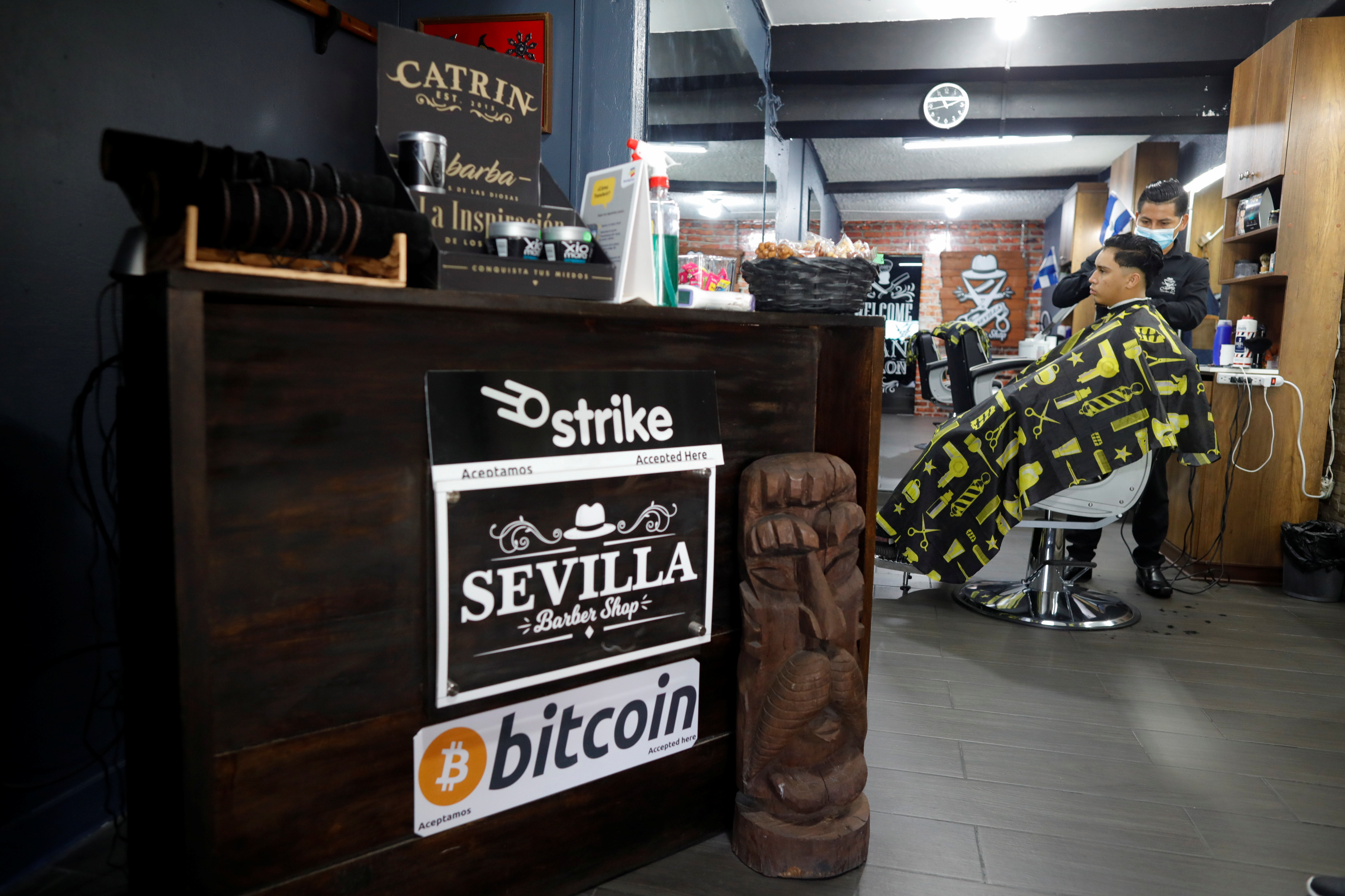 A barber works at Sevilla Barber Shop where Bitcoin is accepted as a payment method, in Santa Tecla, El Salvador September 6, 2021. REUTERS/Jose Cabezas