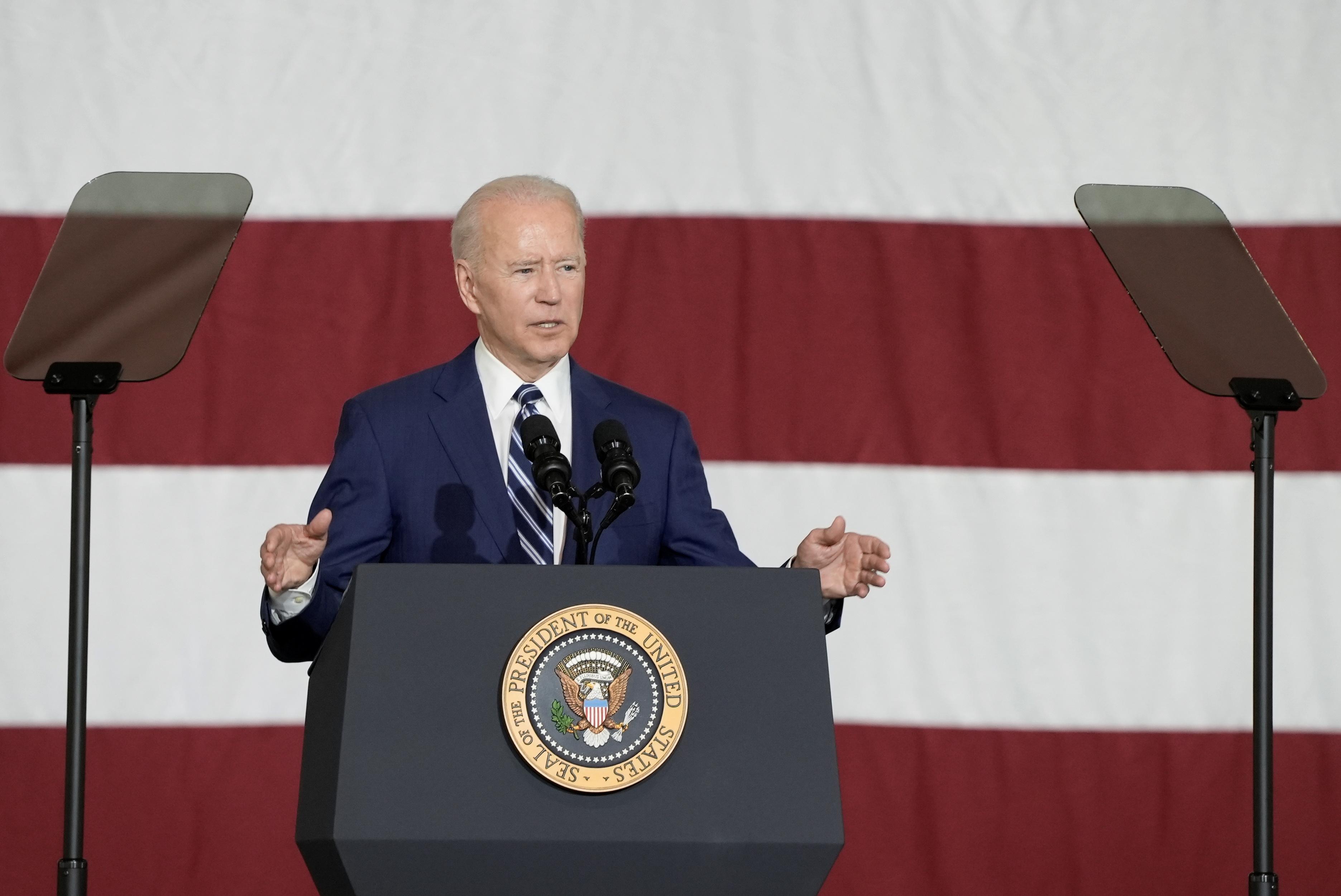 U.S. President Joe Biden speaks as he visits Joint Base Langley-Eustis with first lady Jill Biden, in Hampton, Virginia, U.S. May 28, 2021. REUTERS/Ken Cedeno
