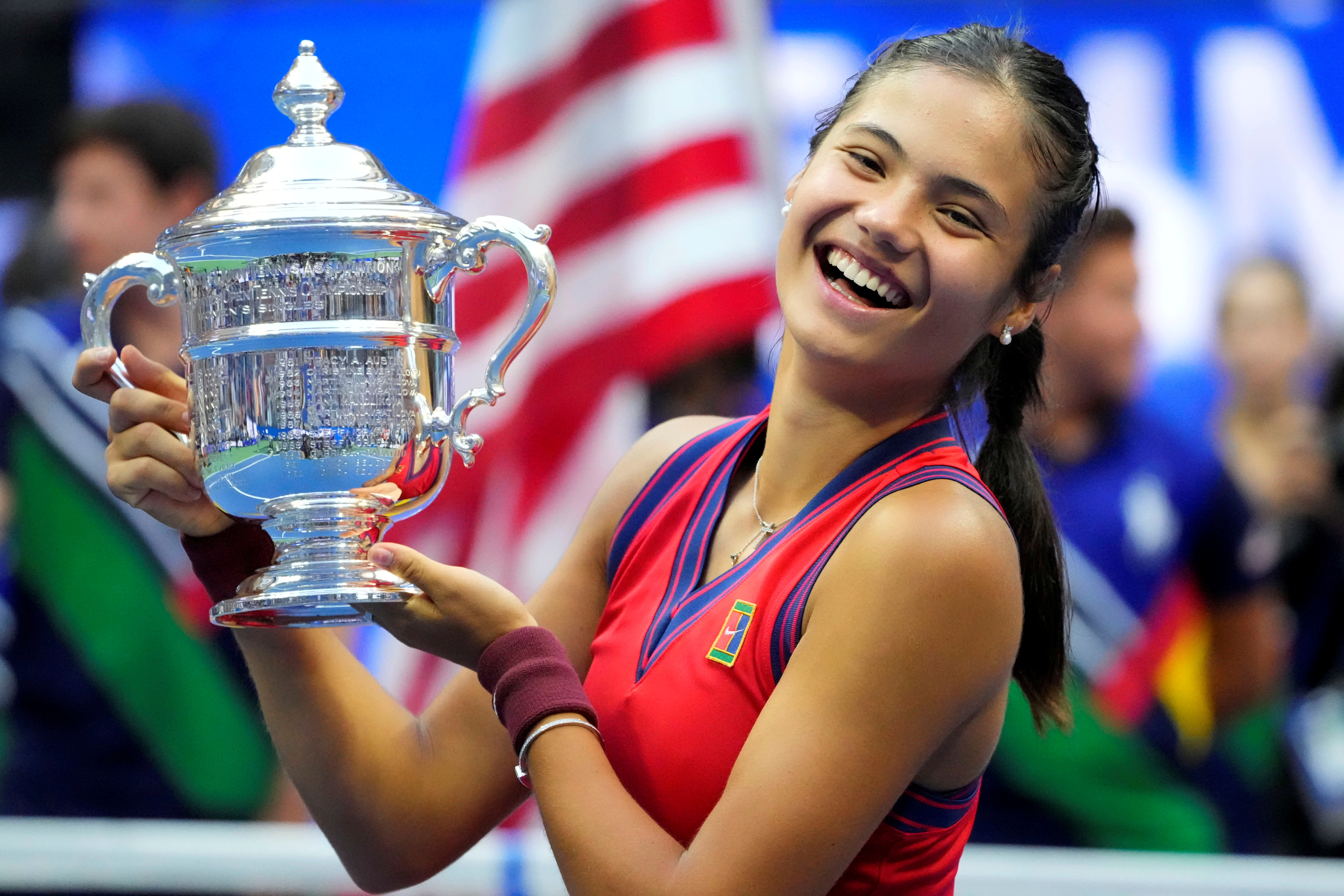 Sep 11, 2021; Flushing, NY, USA; Emma Raducanu of Great Britain celebrates with the U.S. Open trophy after winning her maiden Grand Slam title at the USTA Billie Jean King National Tennis Center. Mandatory Credit: Robert Deutsch-USA TODAY Sports