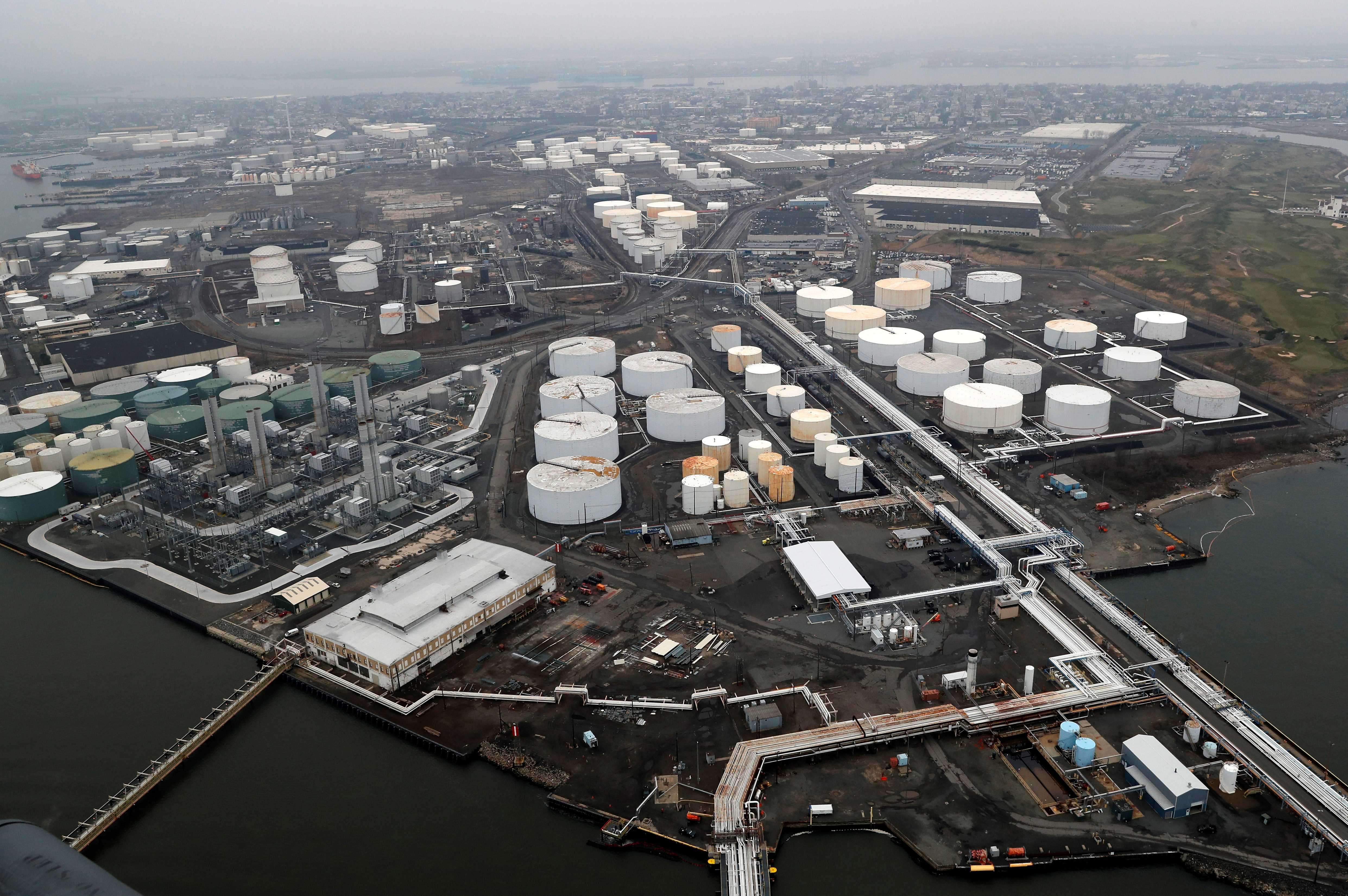 General view of oil tanks and the Bayway Refinery of Phillips 66 in Linden, New Jersey, U.S., March 30, 2020. REUTERS/Mike Segar/File Photo