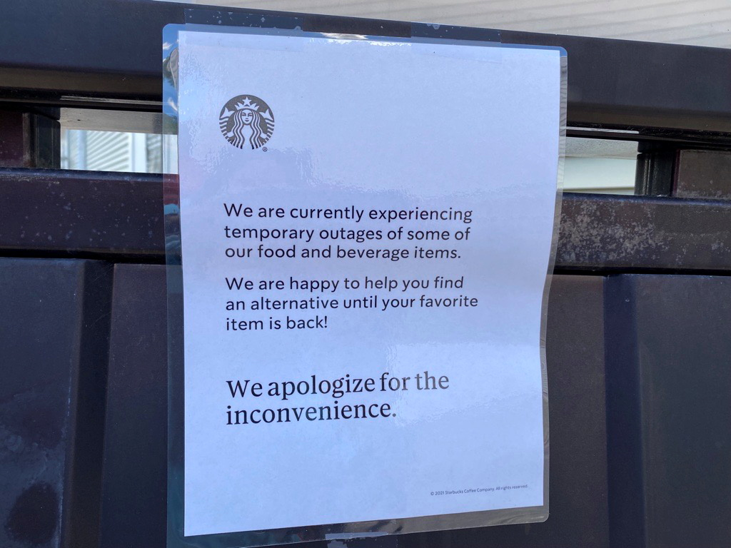 A note is seen attached to a Starbucks drive-through menu alerting customers that some items may be temporarily unavailable in Poughkeepsie, New York, U.S., June 23, 2021. REUTERS/Vanessa O'Connell