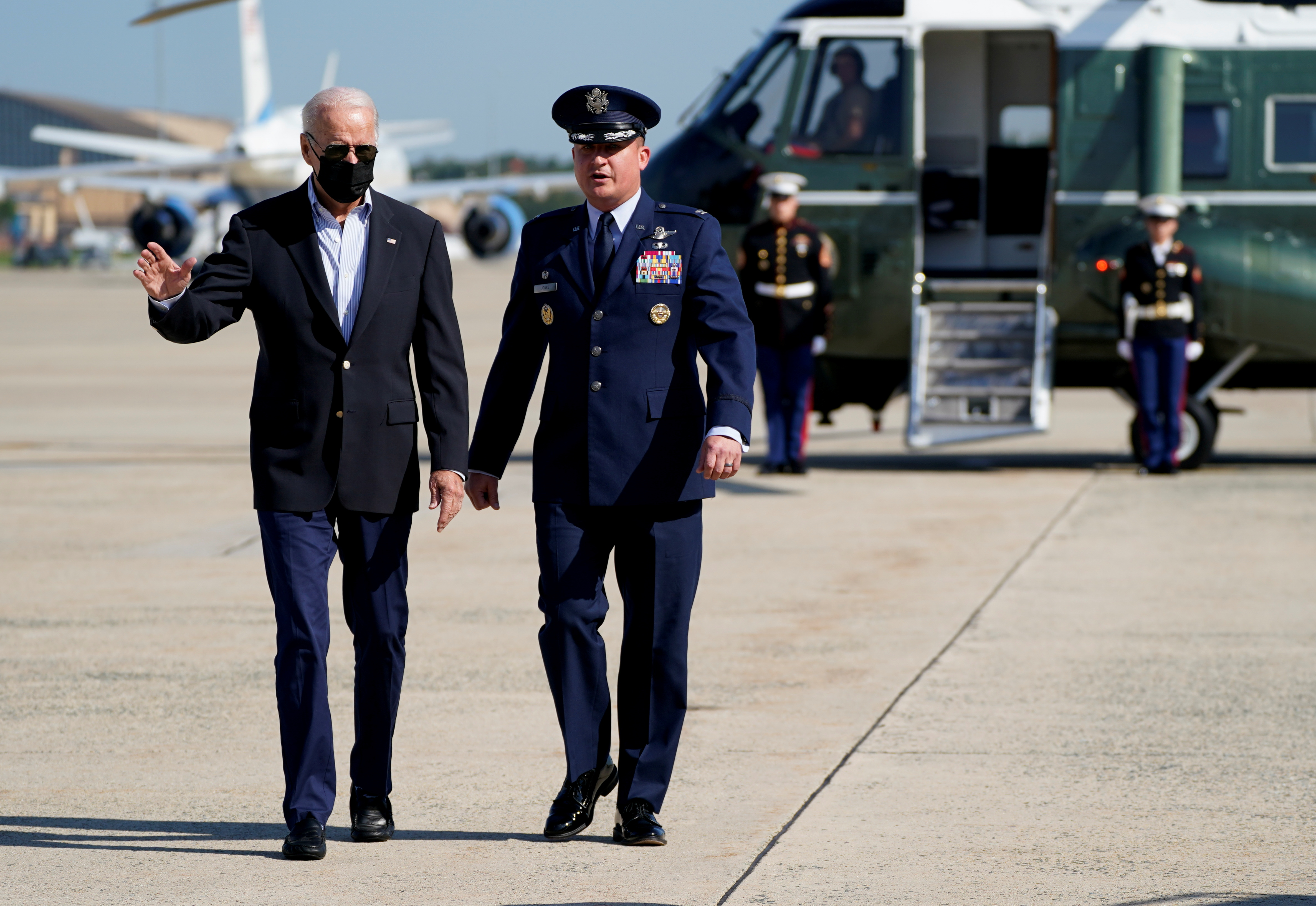 U.S. President Joe Biden walks on the tarmac with Col. Matthew E. Jones, Commander of the 89th Airlift Wing, before departing to visit New York and New Jersey to tour the hurricane-affected areas, from Joint Base Andrews, Maryland, U.S. September 7, 2021. REUTERS/Elizabeth Frantz