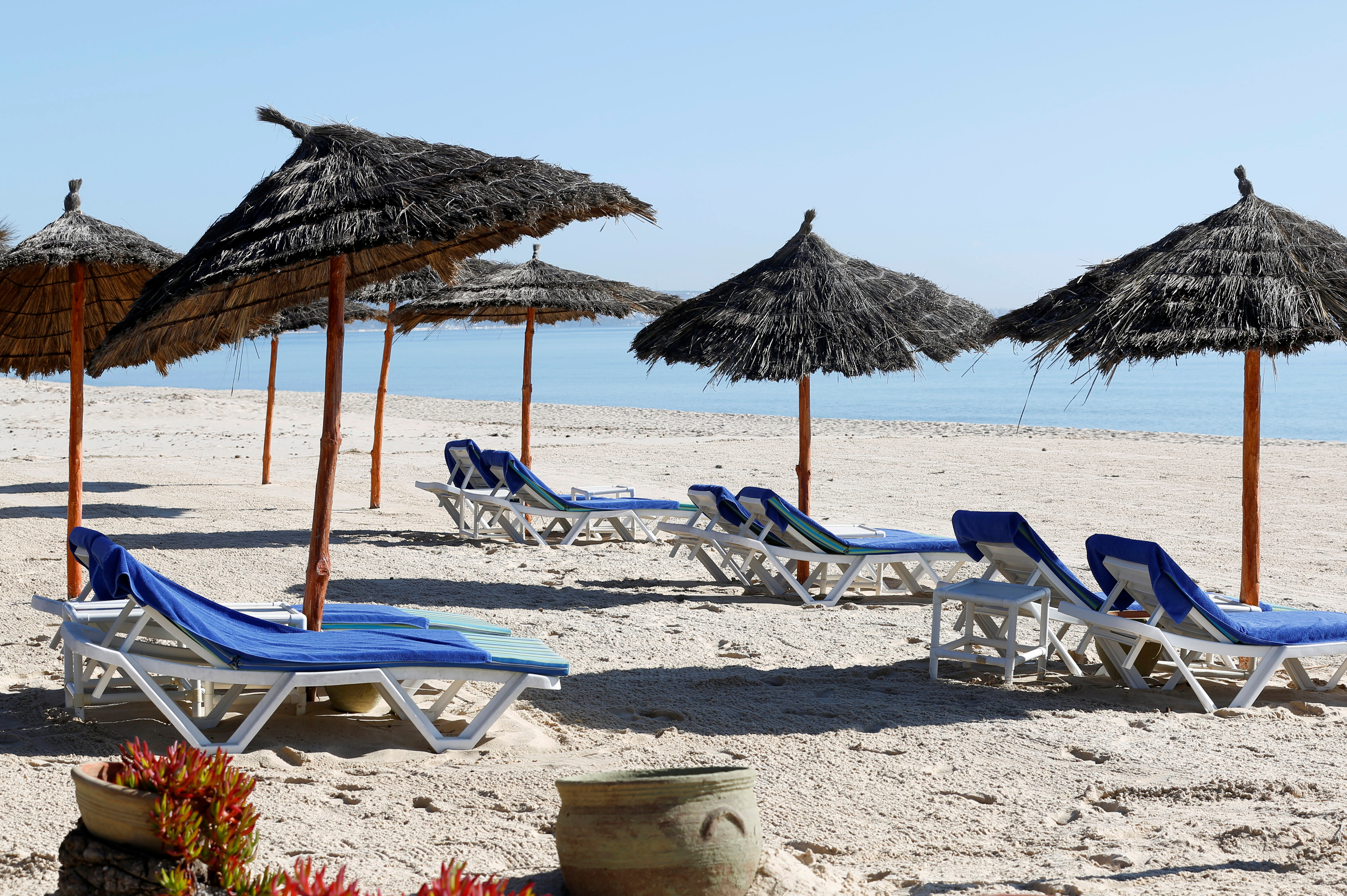 Empty sunbathing chairs are seen on a beach near the Hasdrubal Hotel in Hammamet, Tunisia , March 12, 2020. Picture taken March 12, 2020. REUTERS/Zoubeir Souissi