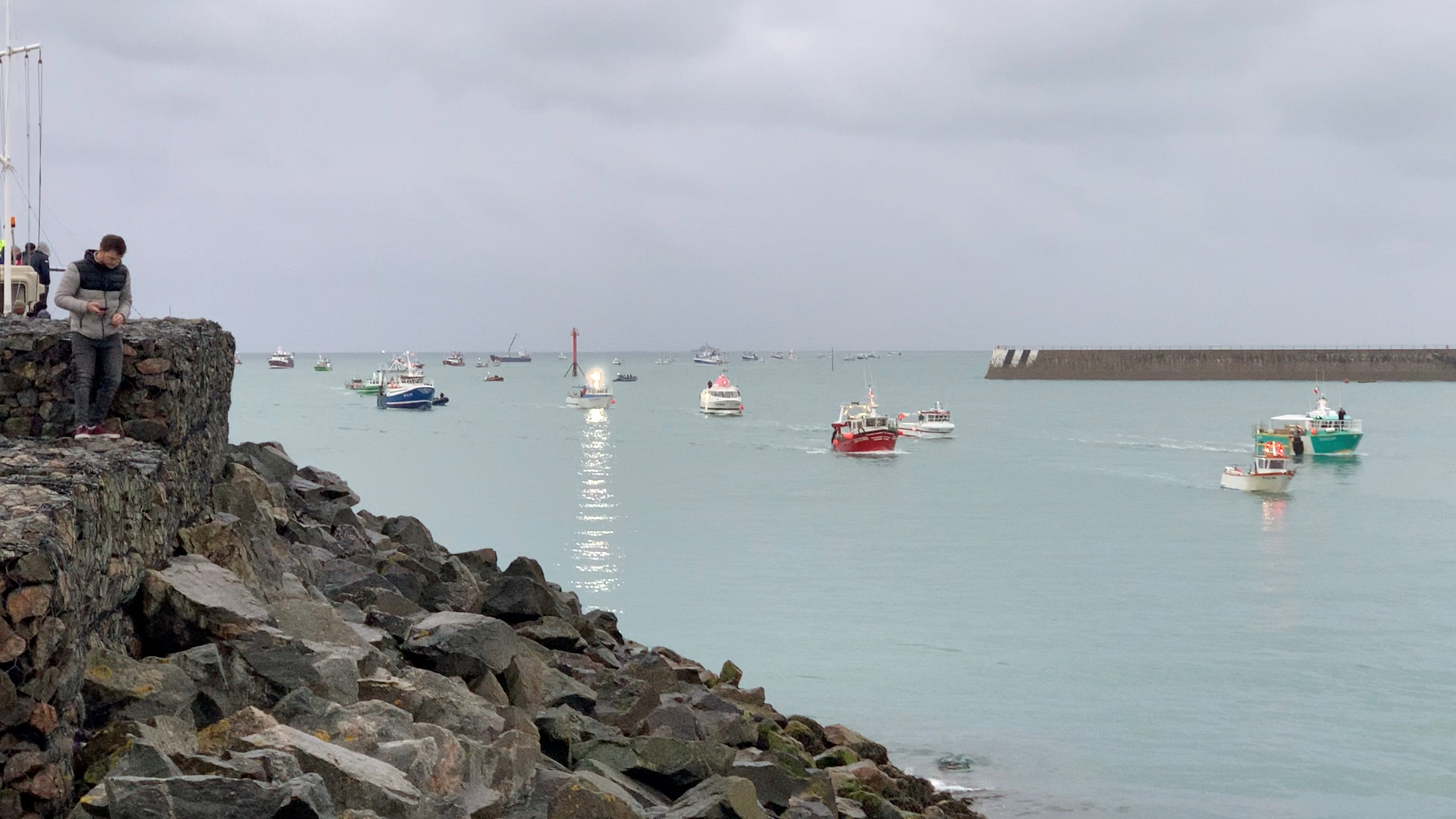 French fishing fleet is seen at the entrance to the harbour in St Helier, Jersey, May 6, 2021 in this still image from a social media video. Marc Le Cornu/via REUTERS