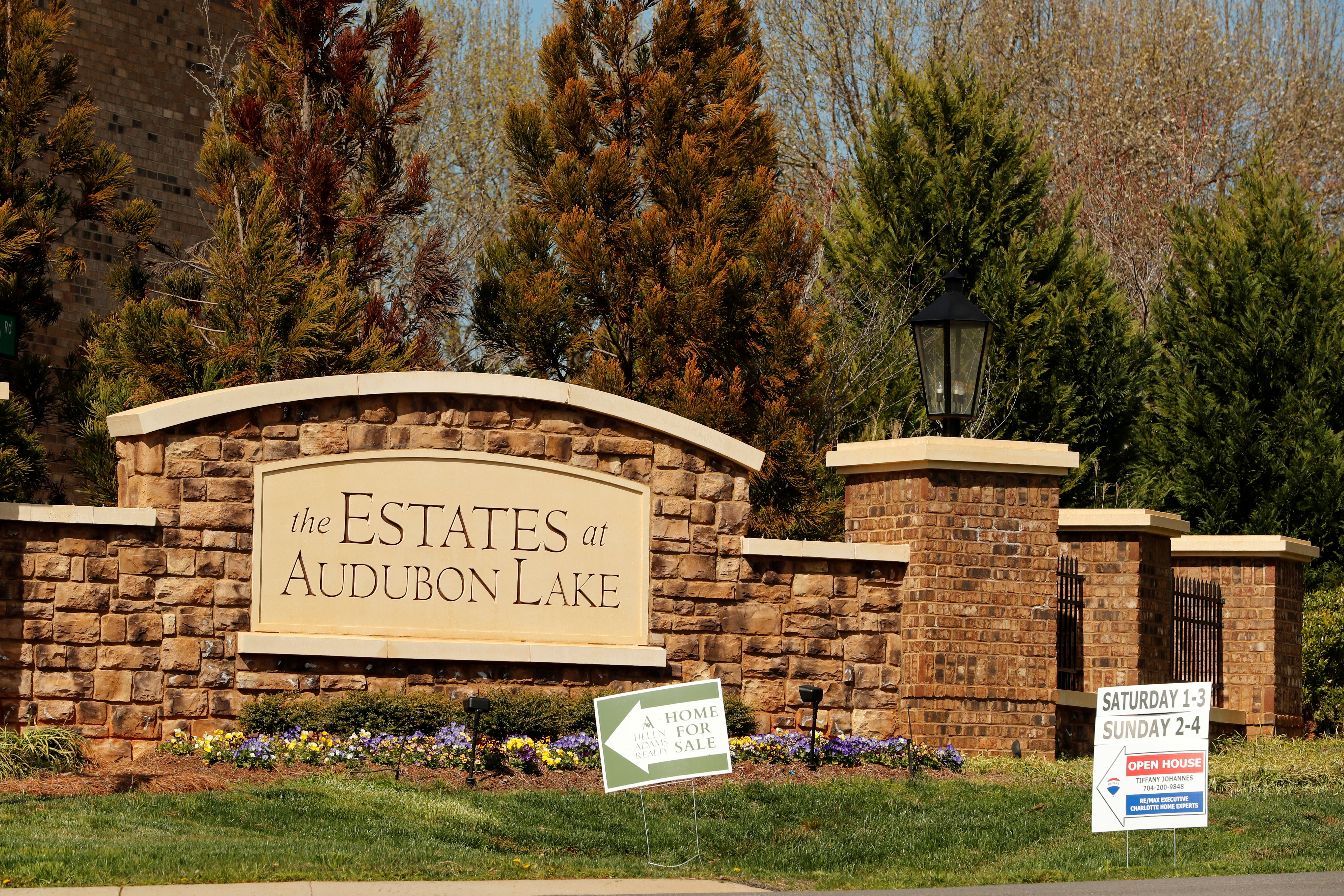 Real estate signs advertise new homes for sale in a new development in York County, South Carolina, U.S., February 29, 2020. REUTERS/Lucas Jackson/File Photo