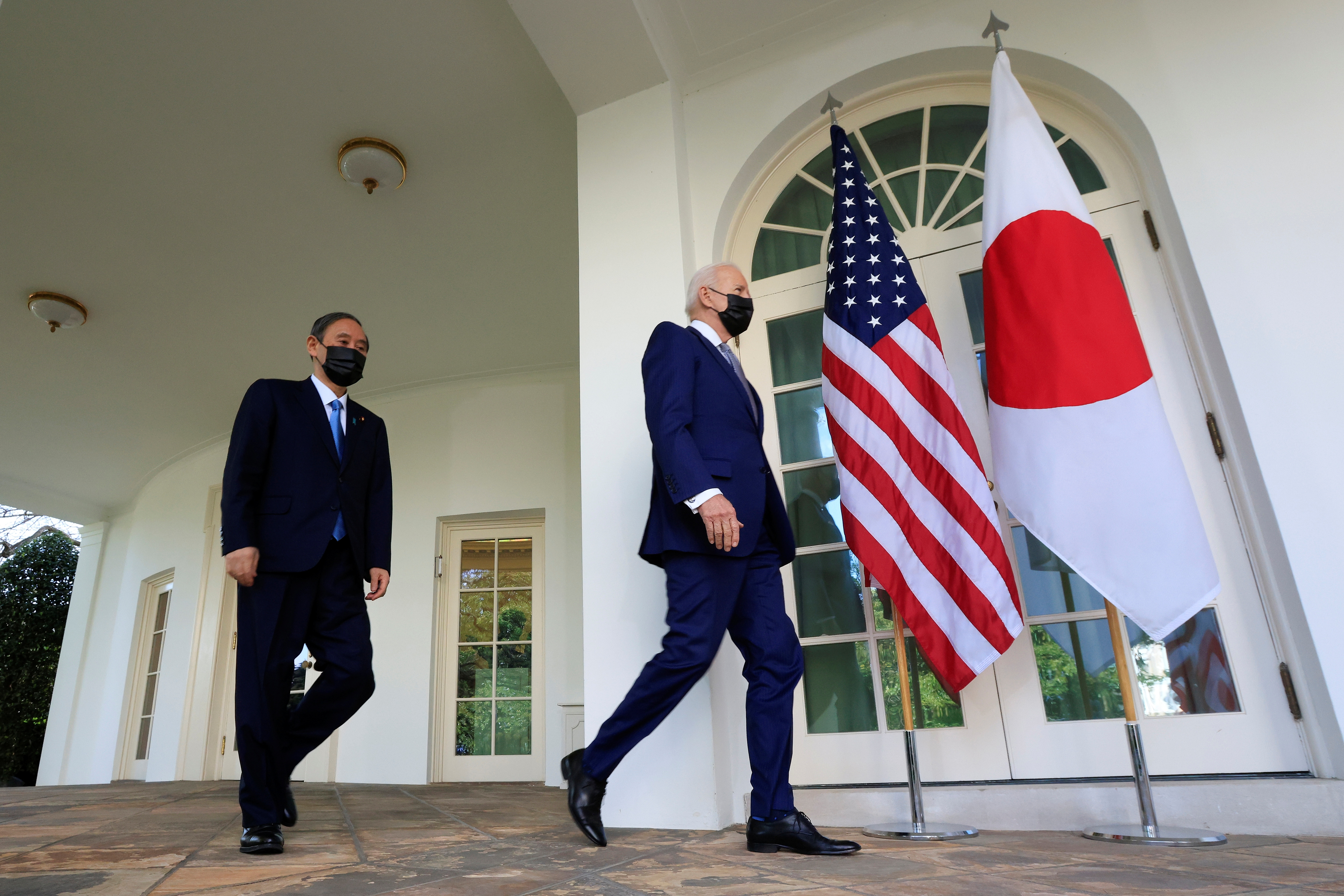 U.S. President Joe Biden walks out of the Oval Office with Japan's Prime Minister Yoshihide Suga ahead of a news conference at the White House in Washington, U.S., April 16, 2021. REUTERS/Tom Brenner