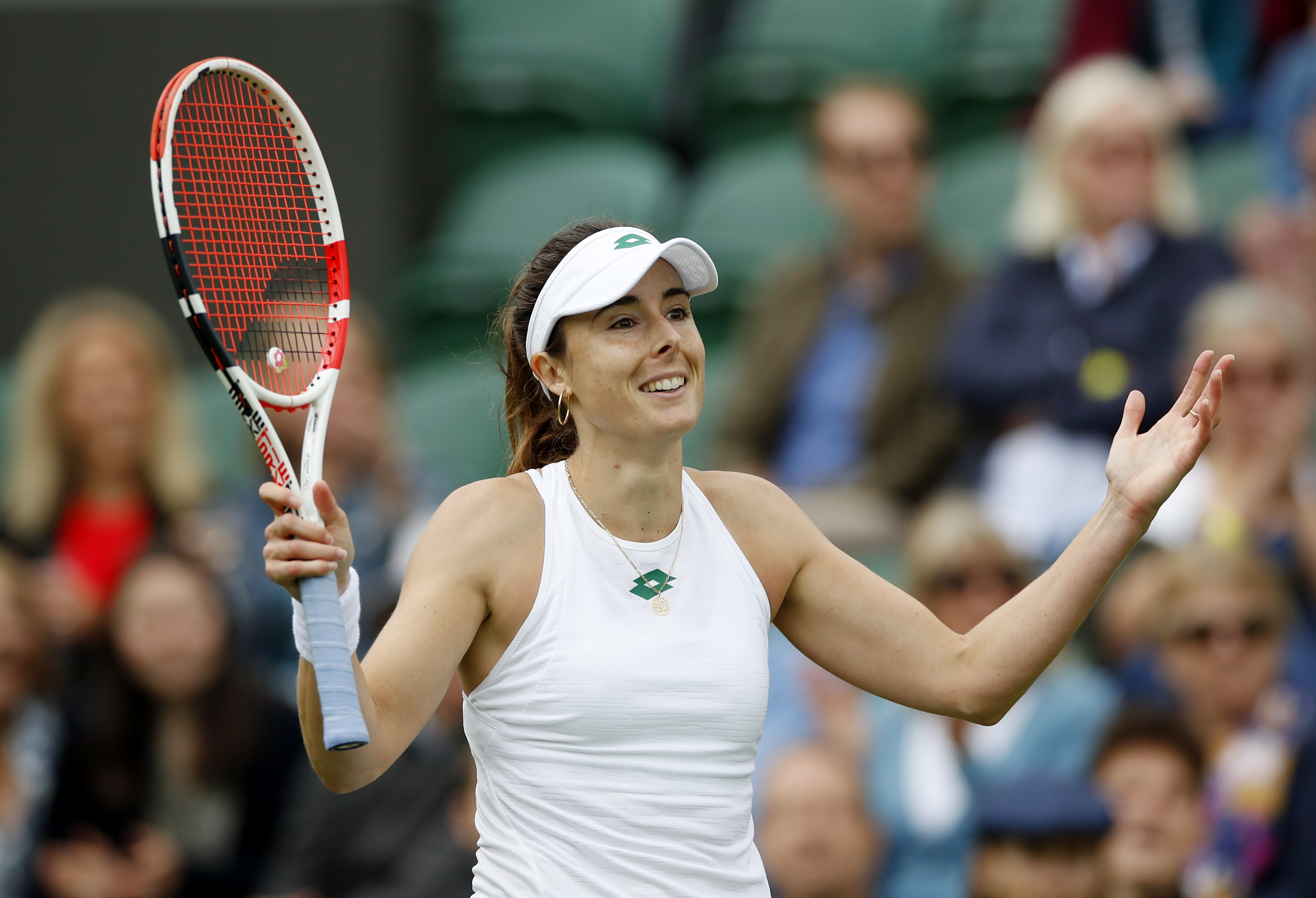 FILE PHOTO-Tennis - Wimbledon - All England Lawn Tennis and Croquet Club, London, Britain - June 30, 2021 France's Alize Cornet celebrates winning her first round match against Canada's Bianca Andreescu REUTERS/Paul Childs