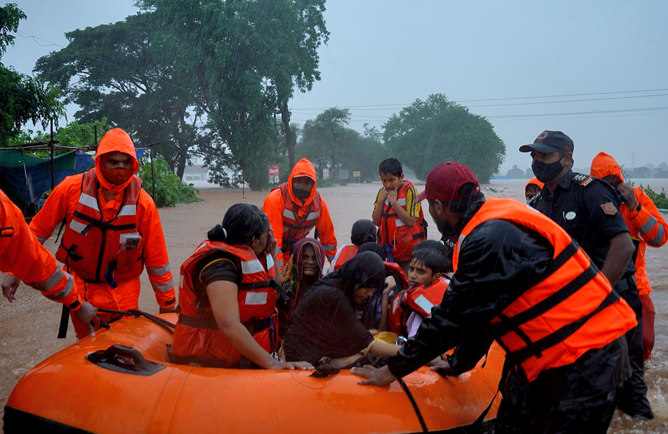 Rescue workers evacuate people from a flooded area to safer places after heavy rains in Kolhapur in the western state of Maharashtra, India, July 23, 2021. REUTERS/Abhijeet Gurjar