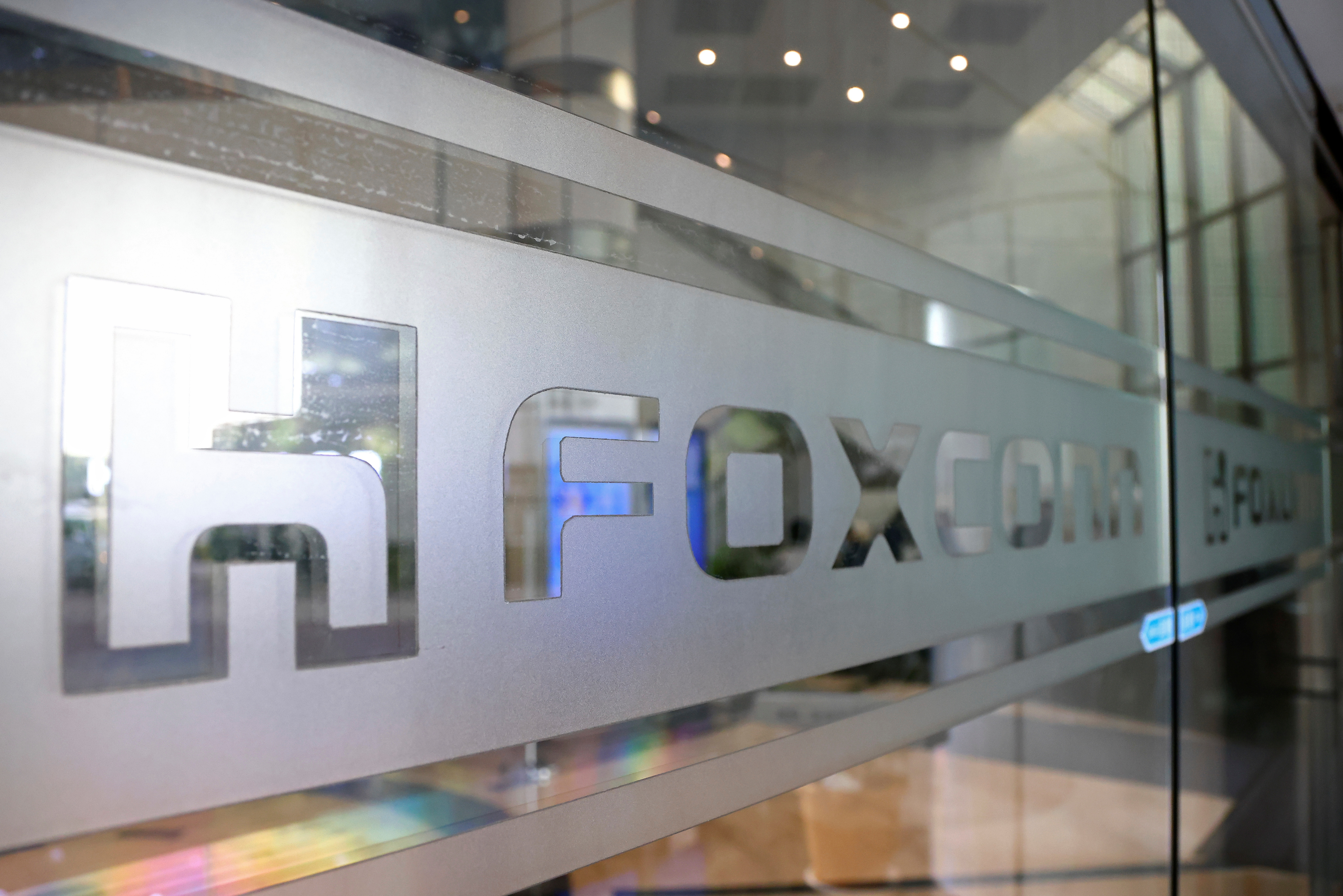 A sign of Foxconn is seen at a glass door inside its office building in Taipei, Taiwan November 12, 2020. REUTERS/Ann Wang