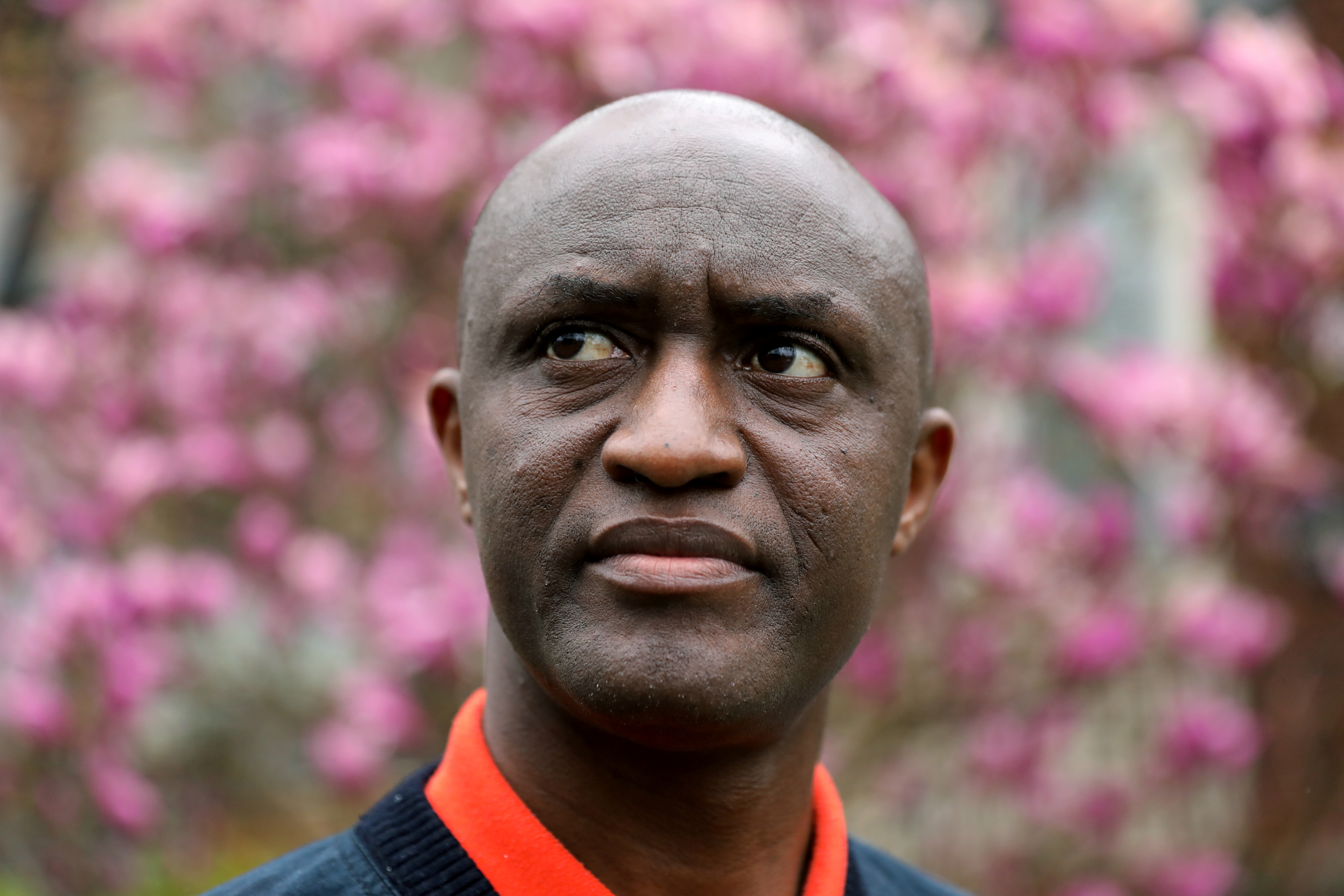 Apollinaire Nduwimana, a Burundian teacher and asylum-seeker who is awaiting a refugee application, poses near his lodging in Toronto, Ontario, Canada April 29, 2021. Picture taken April 29, 2021. REUTERS/Chris Helgren