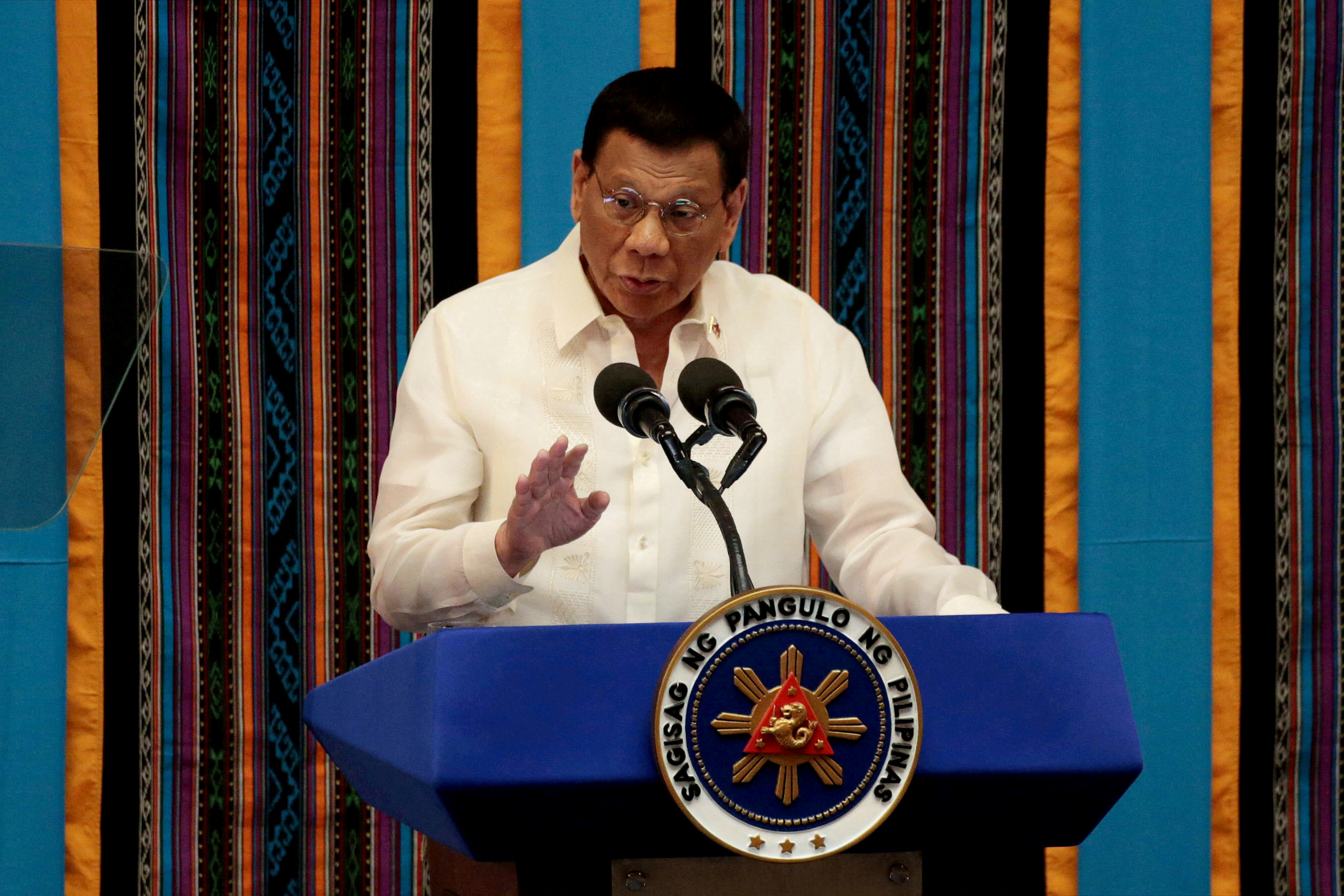 Philippine President Rodrigo Duterte gestures during his fourth State of the Nation address at the Philippine Congress in Quezon City, Metro Manila, Philippines, July 22, 2019. REUTERS/Eloisa Lopez/File Photo