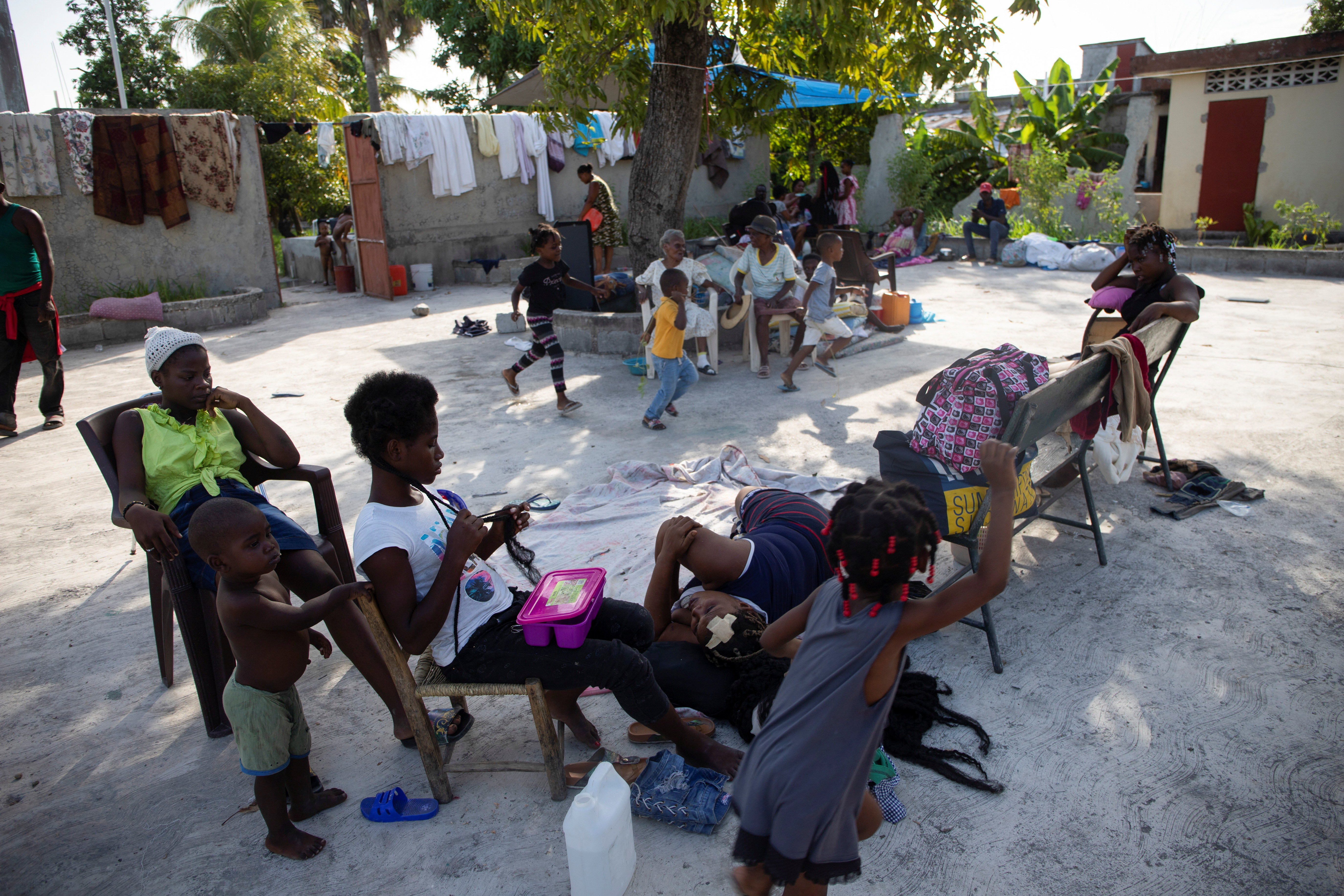 People are pictured on a street after a 7.2 magnitude earthquake in Les Cayes, Haiti August 15, 2021.  REUTERS/Estailove St-Val