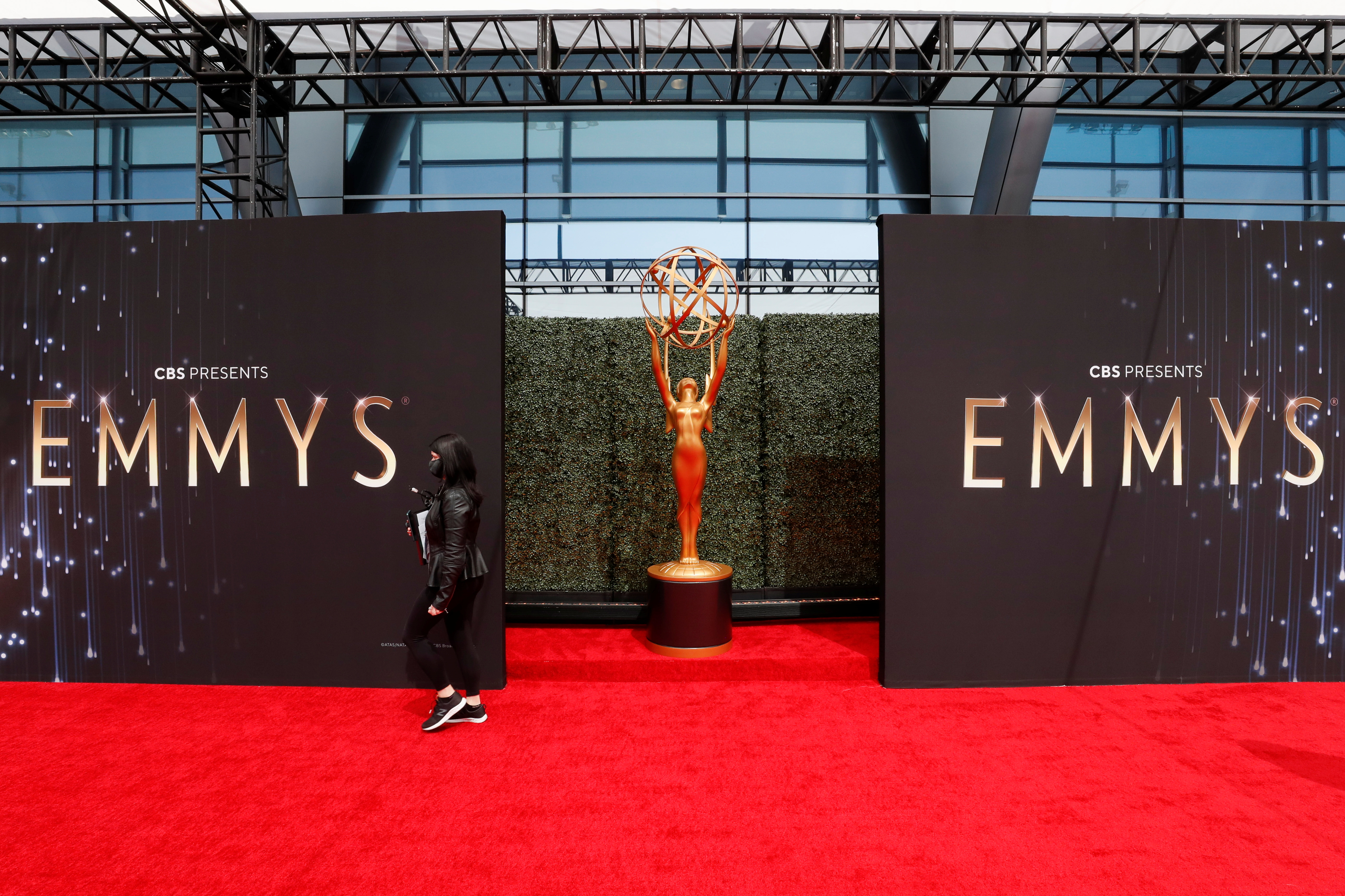 A person walks on the red carpet ahead of the 73rd Primetime Emmy Awards in Los Angeles, U.S., September 19, 2021. REUTERS/Mario Anzuoni