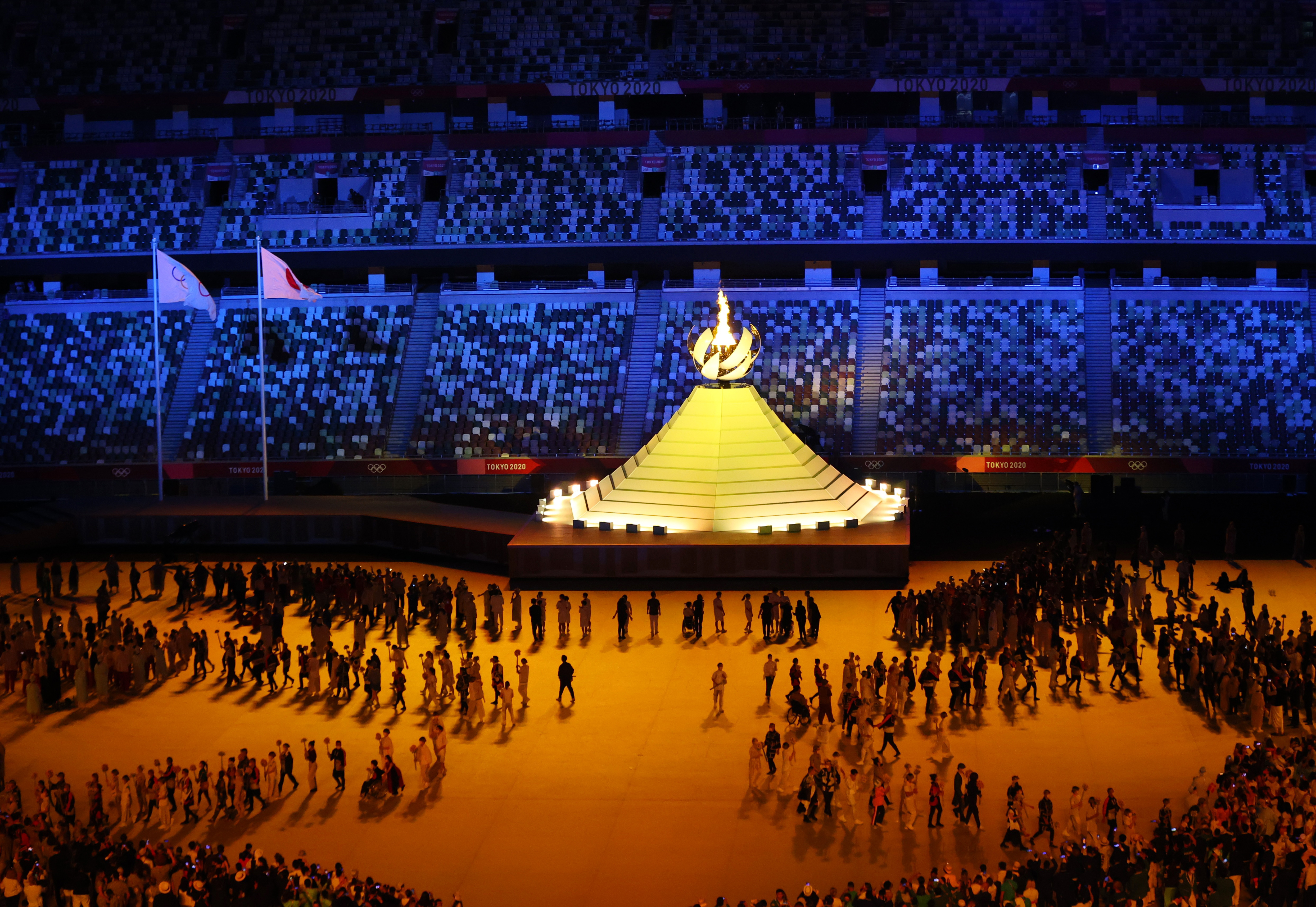 Tokyo 2020 Olympics - The Tokyo 2020 Olympics Opening Ceremony - Olympic Stadium, Tokyo, Japan - July 23, 2021. The Olympic cauldron is lit by Naomi Osaka during the opening ceremony REUTERS/Marko Djurica