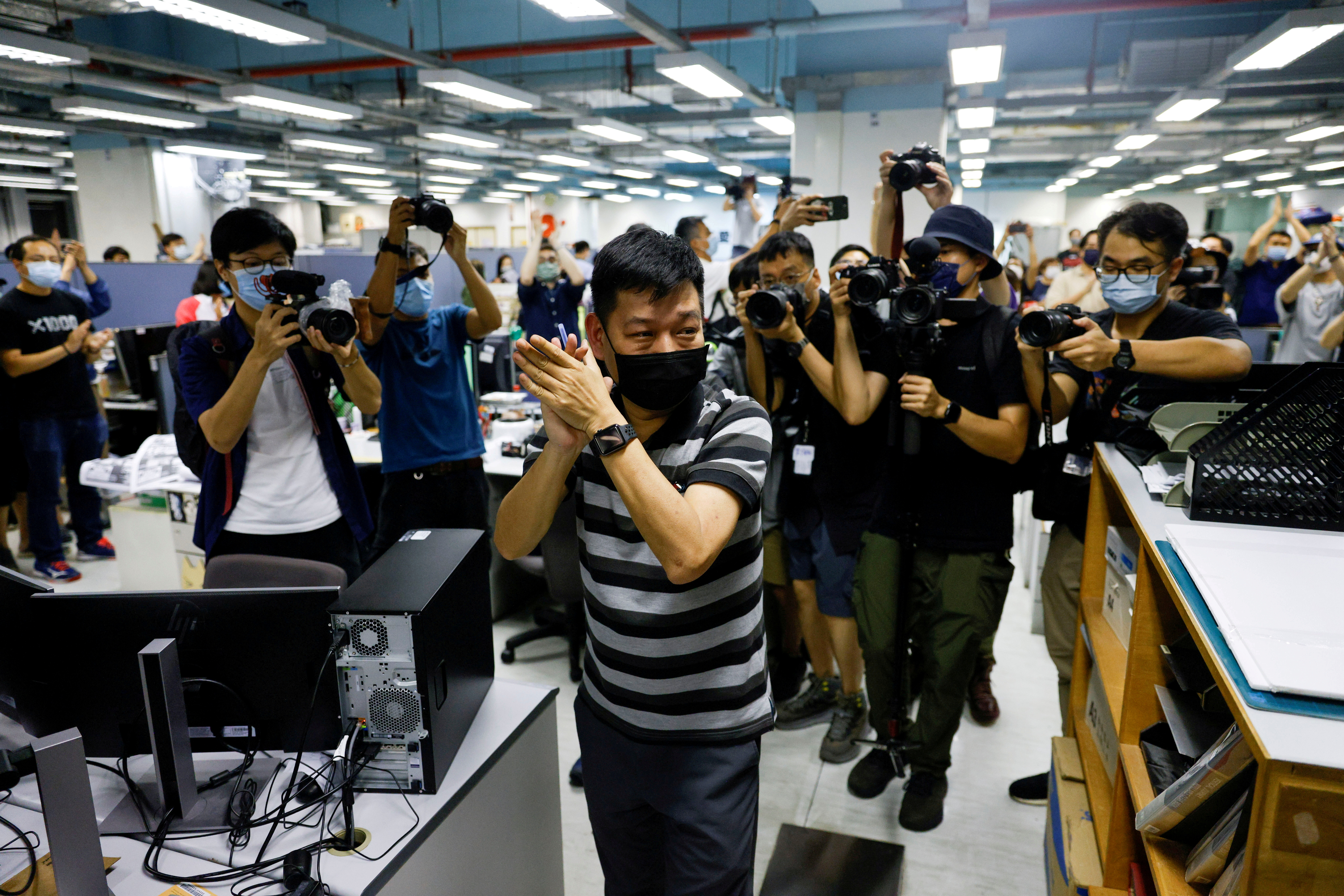 FILE PHOTO: Lam Man-chung, Executive Editor-in-Chief of Apple Daily reacts on the day of the newspaper's final edition in Hong Kong, China June 23, 2021. REUTERS/Tyrone Siu/File Photo/File Photo