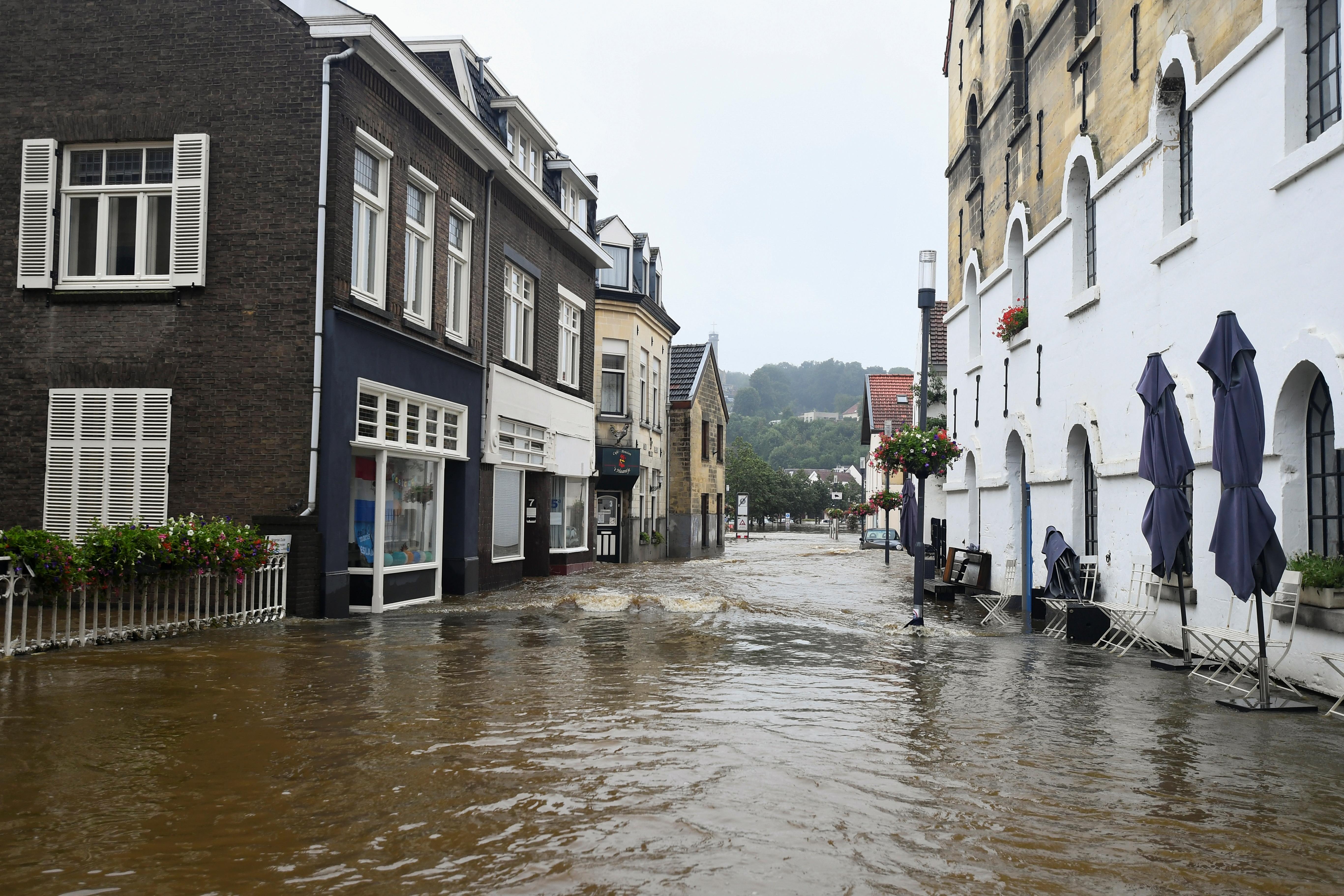 A flooded street is seen following heavy rainfalls in Valkenburg, Netherlands, July 15, 2021. REUTERS/Piroschka Van De Wouw