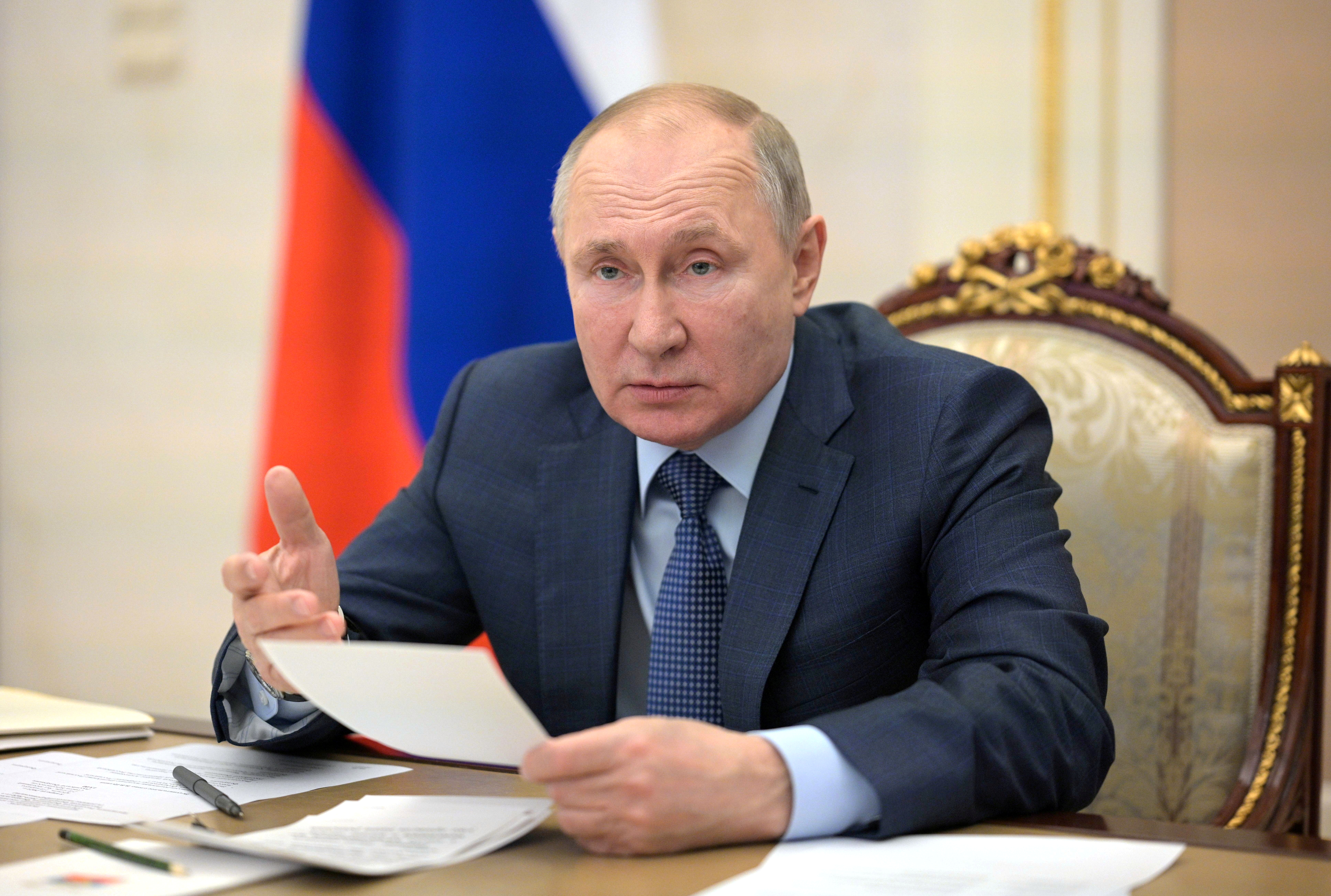 Russian President Vladimir Putin chairs a meeting with senior members of the government, via a video conference call at the Kremlin in Moscow, Russia April 8, 2021. Sputnik/Alexei Druzhinin/Kremlin via REUTERS