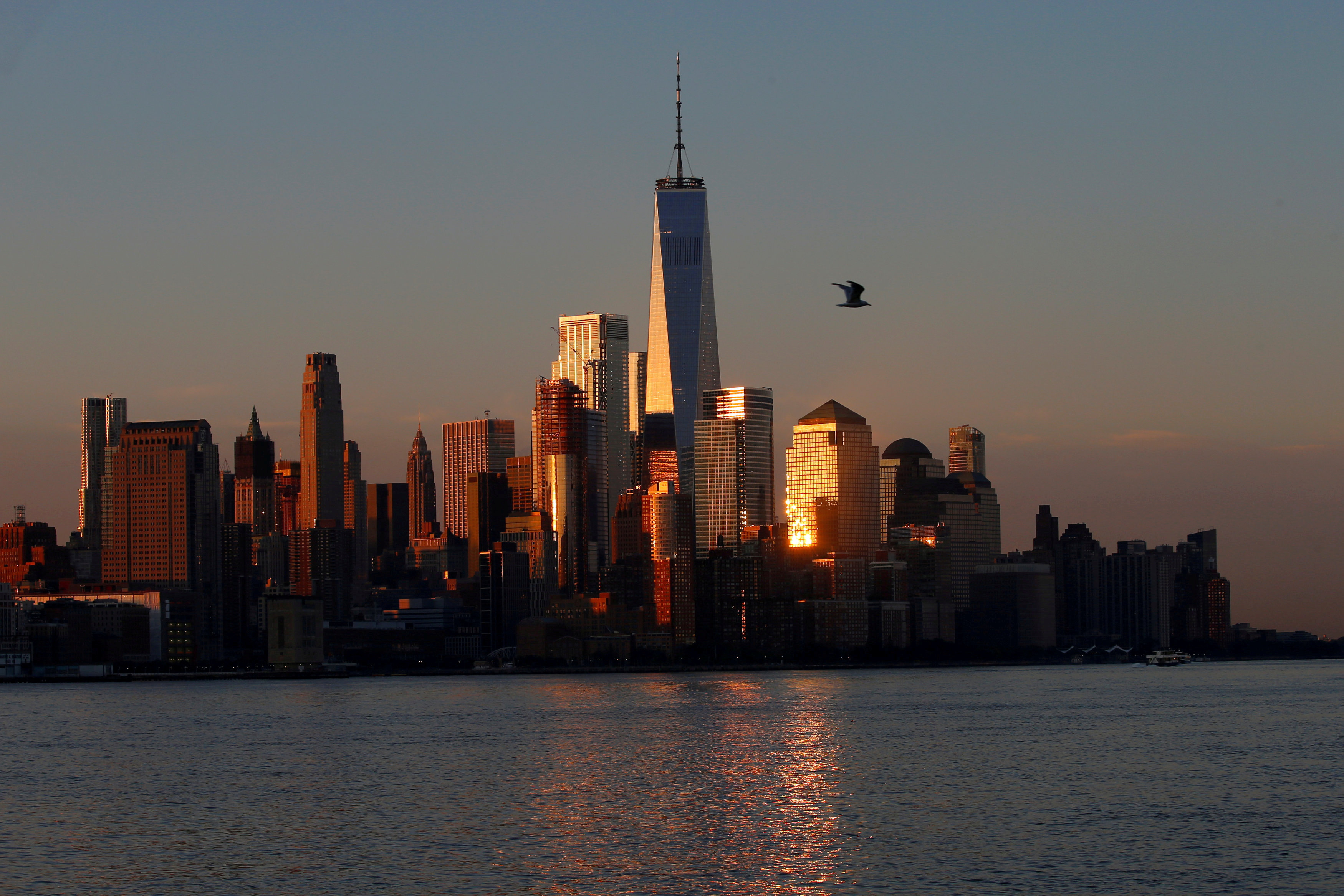A view of the One World Trade Centre tower and the lower Manhattan skyline of New York City at sunrise as seen from Hoboken, New Jersey, U.S., August 9, 2017. REUTERS/Mike Segar/File Photo