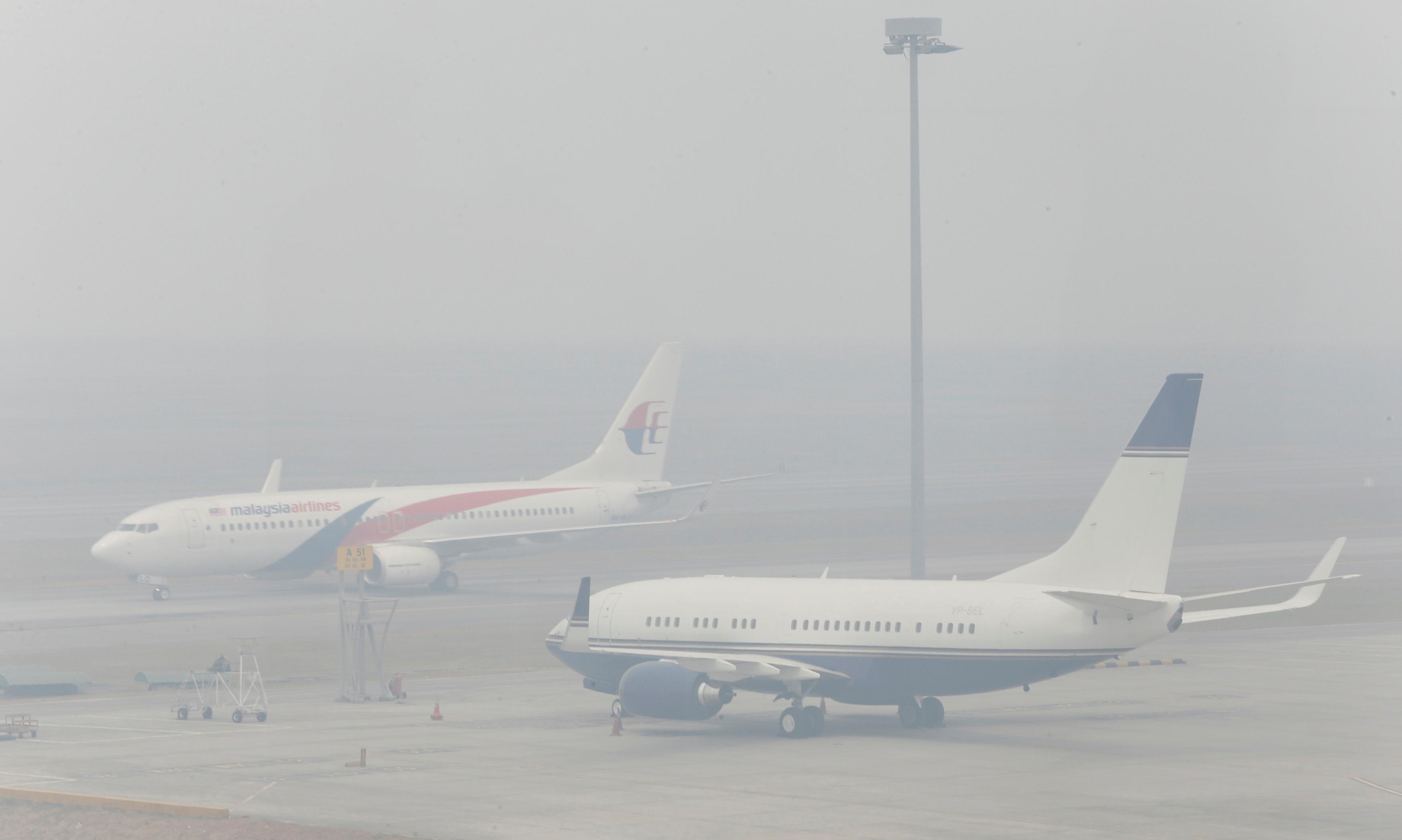 Airplanes are seen at the Kuala Lumpur International Airport in Sepang, on a hazy day outside Kuala Lumpur June 24, 2013. REUTERS/Bazuki Muhammad/File Photo