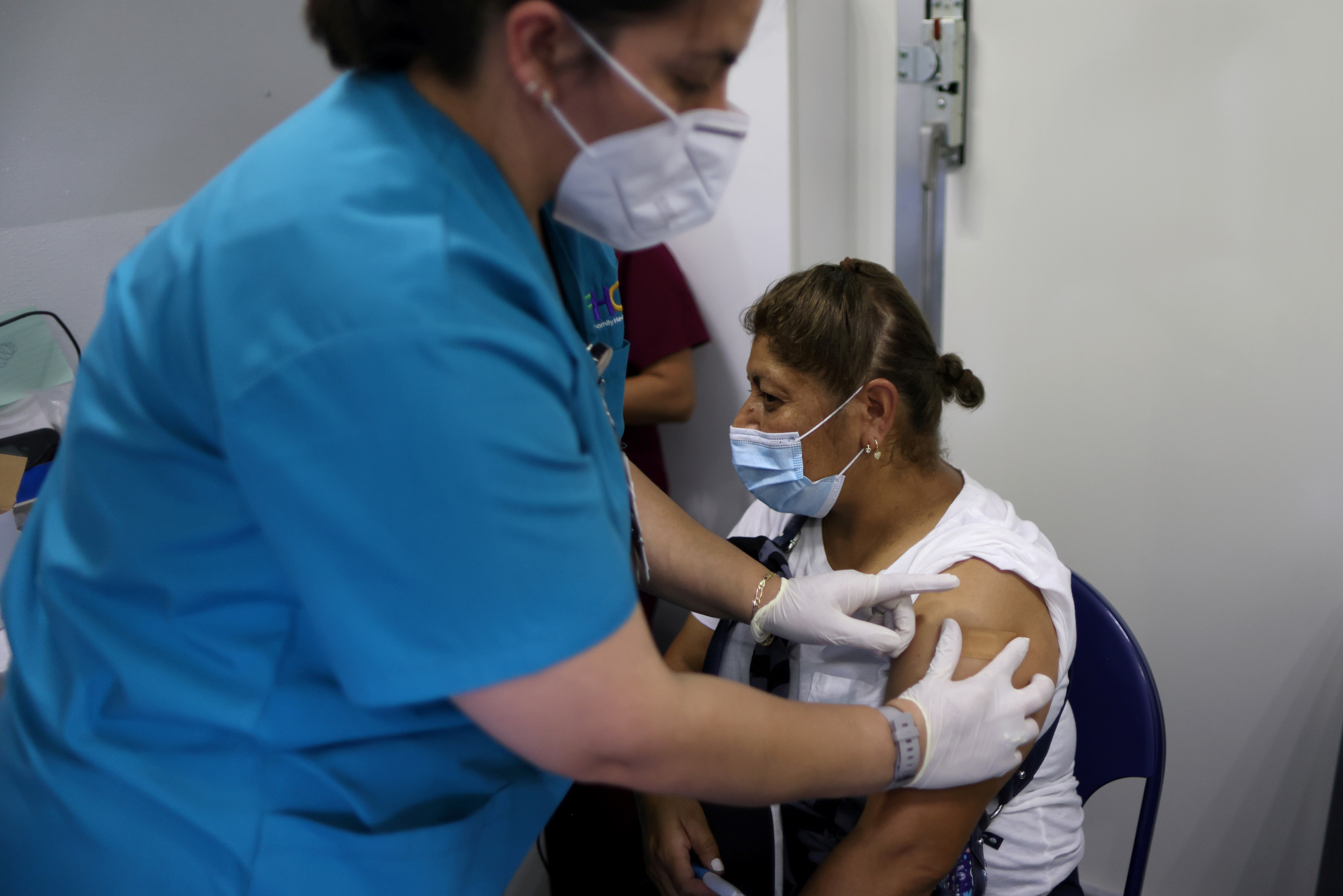 Olga Orduna, 46, receives her second coronavirus disease (COVID-19) vaccine at a back-to-school clinic in South Gate, Los Angeles, California, U.S., August 12, 2021. REUTERS/Lucy Nicholson