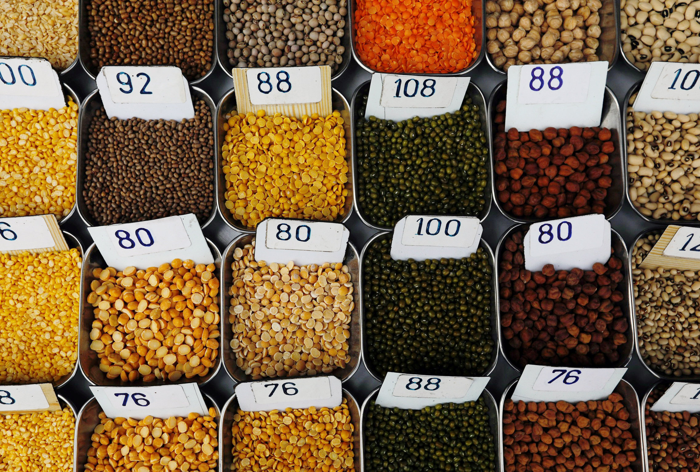 Price tags are seen on the samples of pulses that are kept on display for sale at a market in Mumbai, India January 29, 2018. REUTERS/Danish Siddiqui/File photo
