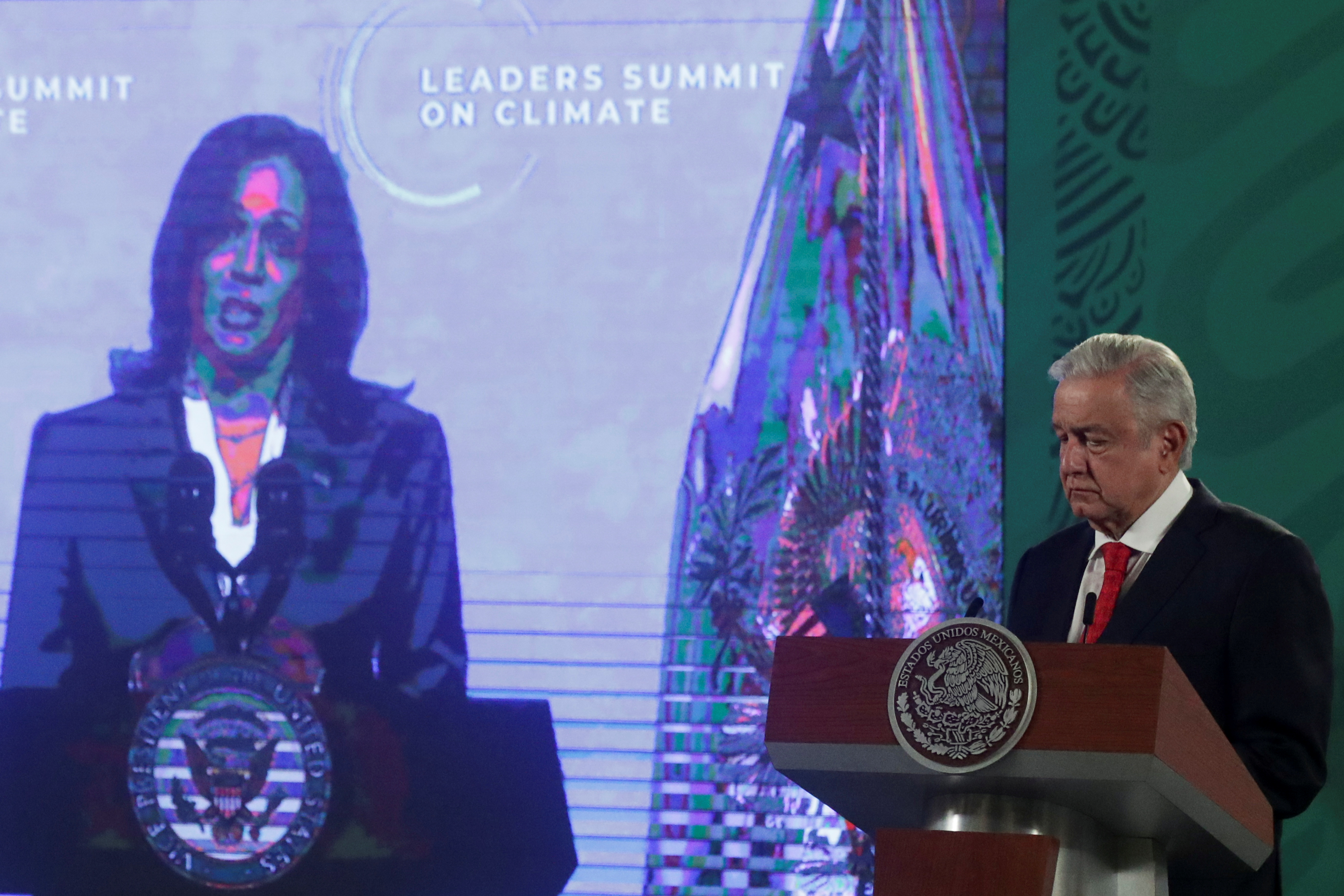 File photo: U.S. Vice President Kamala Harris is seen on the screen as Mexico's President Andres Manuel Lopez Obrador attends a virtual U.S. global climate summit, at the National Palace in Mexico City, Mexico, April 22, 2021. REUTERS/Henry Romero