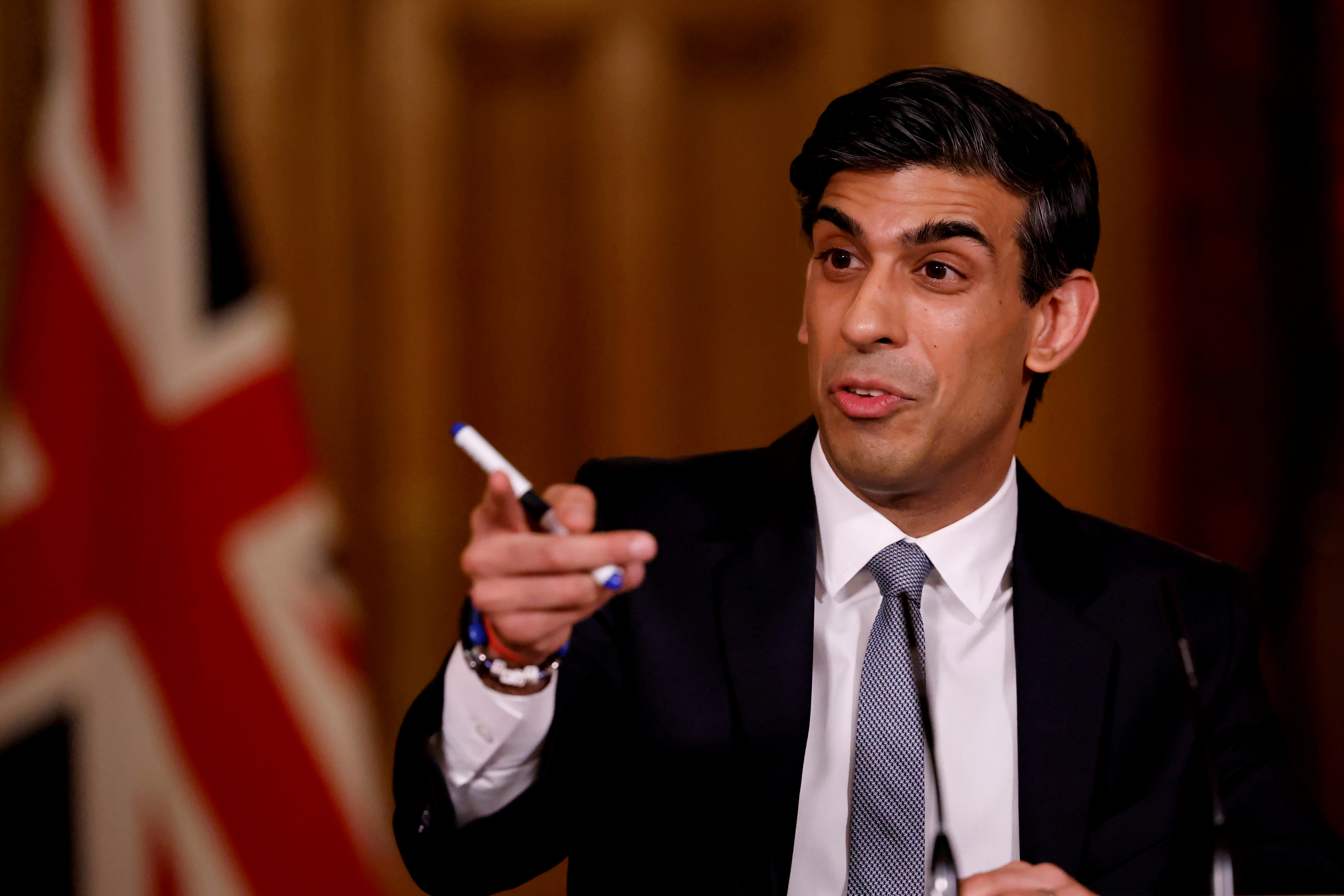 British finance minister Rishi Sunak attends a virtual press conference inside 10 Downing Street in central London, Britain March 3, 2021.