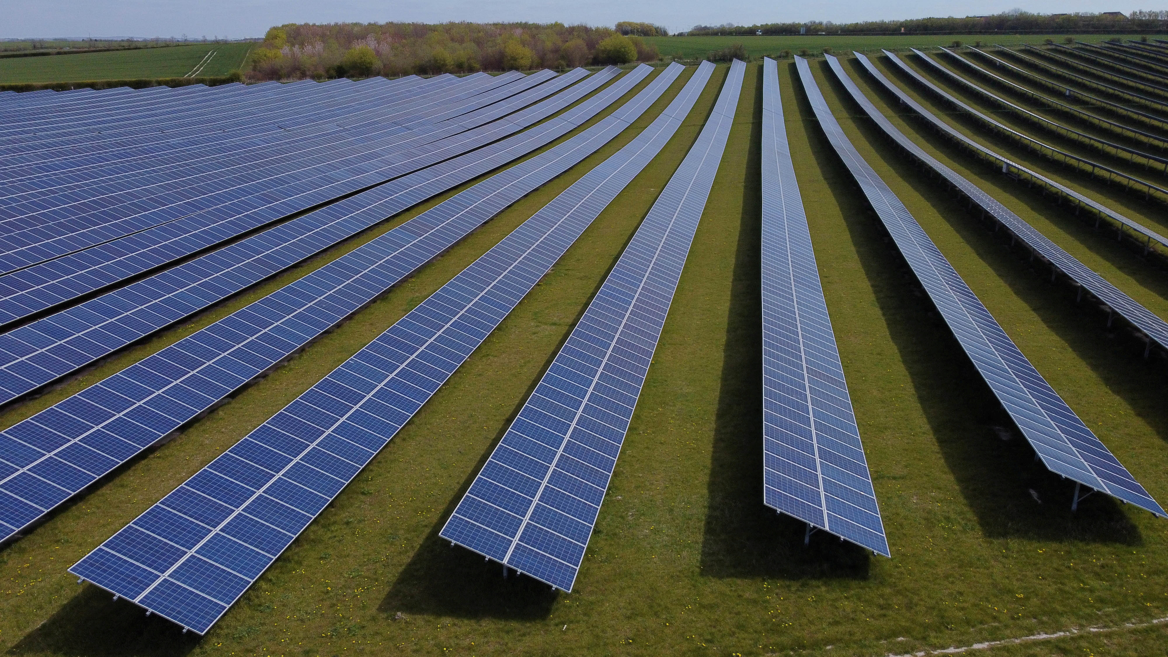 A field of solar panels is seen near Royston, Britain, April 26, 2021. Picture taken with a drone. REUTERS/Matthew Childs/File Photo