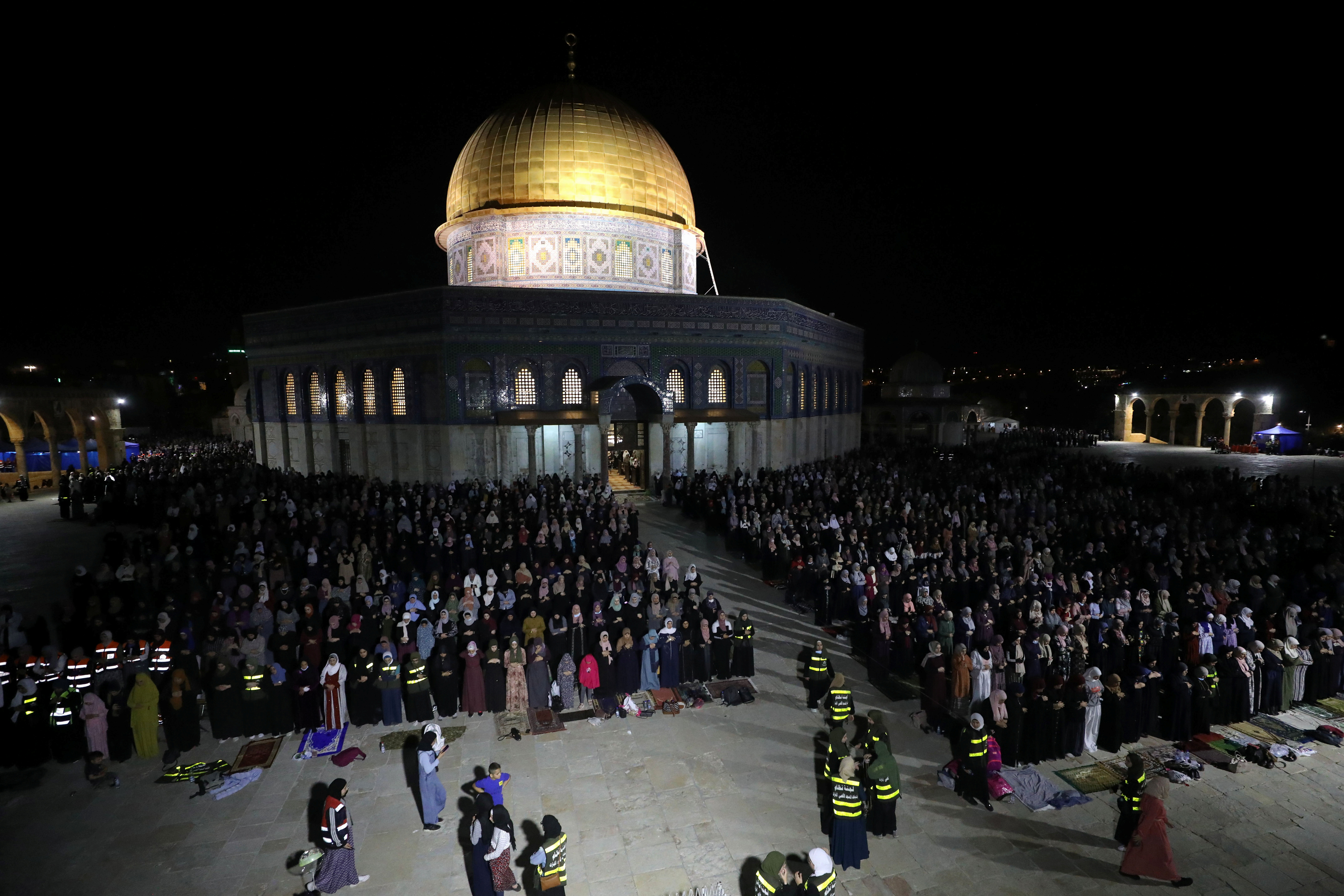 Palestinians pray in front of the Dome of the Rock on Laylat al-Qadr during the holy month of Ramadan, at the compound that houses Al-Aqsa Mosque, known to Muslims as Noble Sanctuary and to Jews as Temple Mount, in Jerusalem's Old City, May 8, 2021. REUTERS/Ammar Awad
