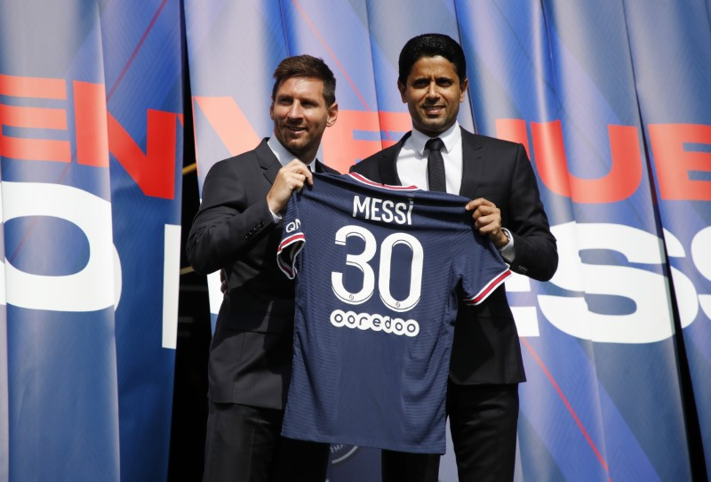 Soccer Football - Lionel Messi Press Conference after signing for Paris St Germain - Parc des Princes, Paris, France - August 11, 2021 Paris St Germain's Lionel Messi and president Nasser Al-Khelaifi pose with a shirt on the pitch after the press conference REUTERS/Sarah Meyssonnier