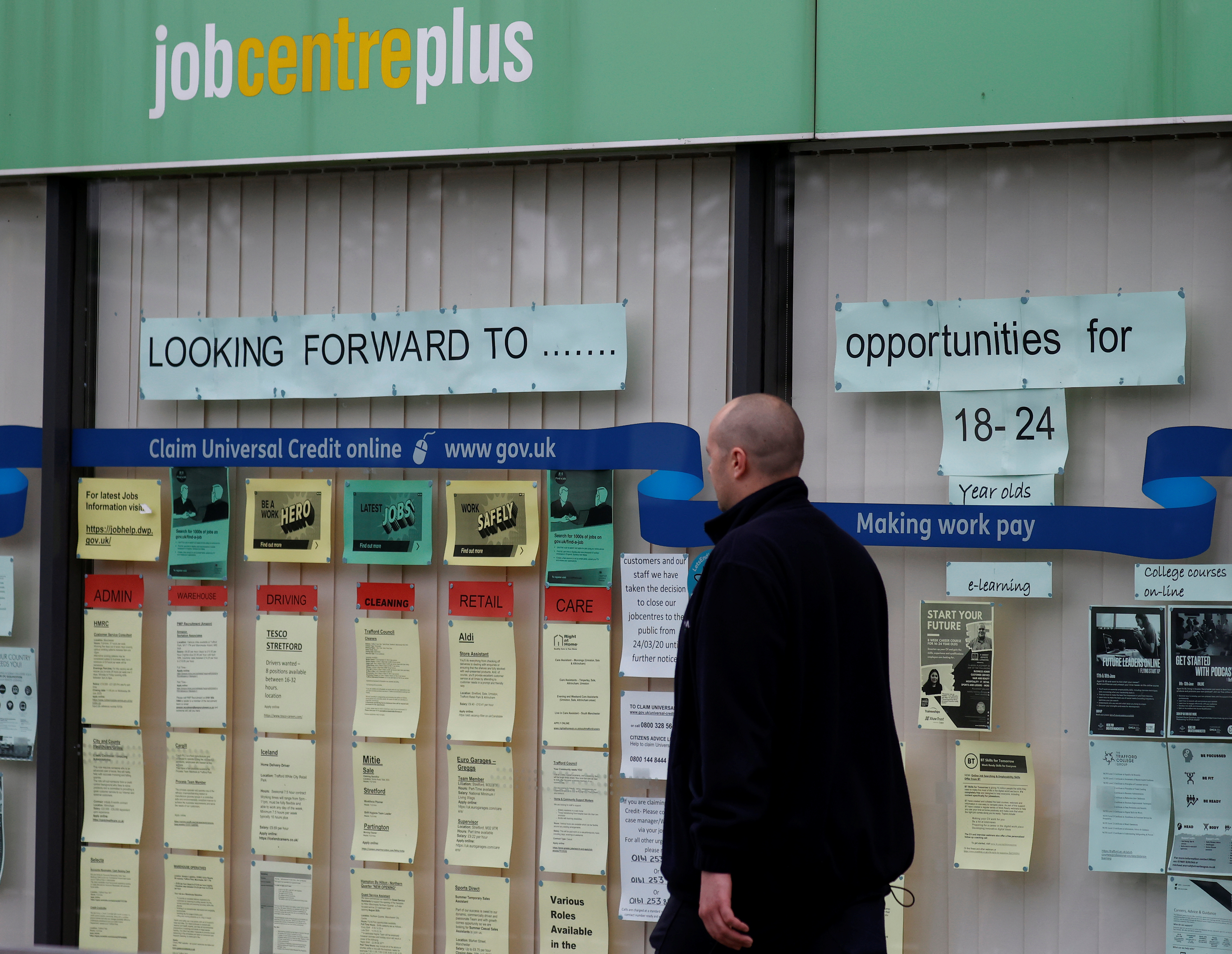 A man walks past a job centre following the outbreak of the coronavirus disease (COVID-19), in Manchester, Britain, July 8, 2020. REUTERS/Phil Noble