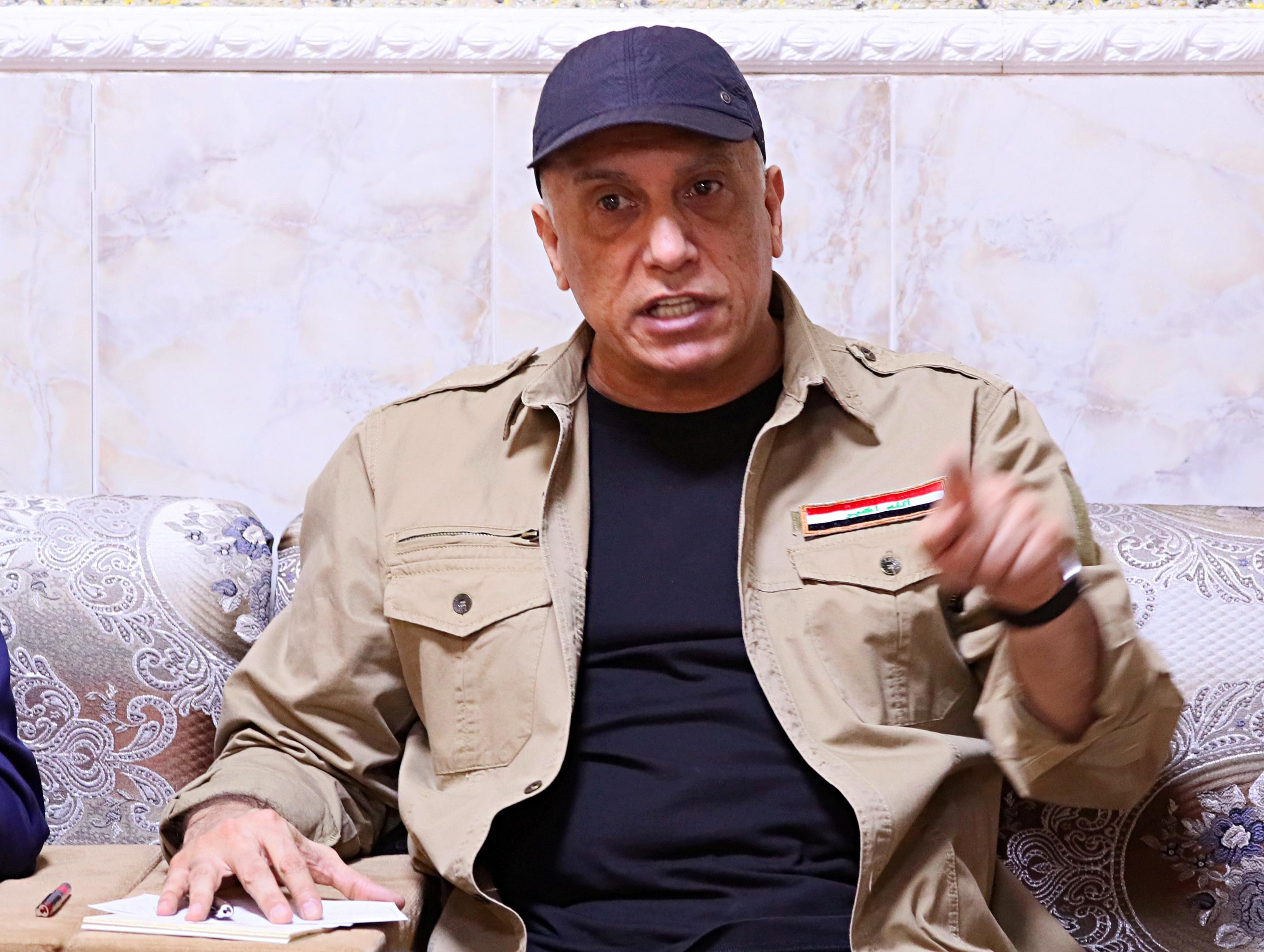 Iraqi Prime Minister Mustafa al-Kadhimi speaks to locals in Tarmiyah, Iraq July 20, 2020. Khalid Mohammed/Pool via REUTERS