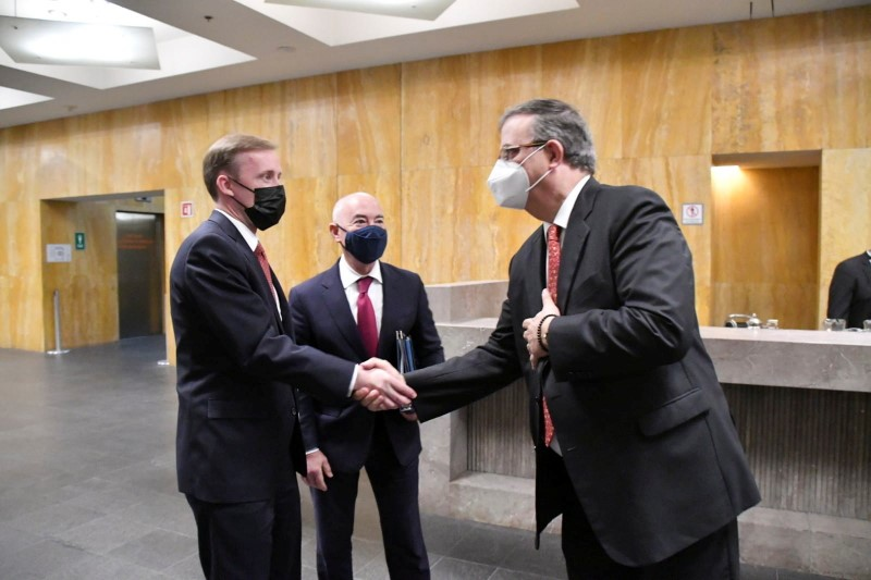 Mexican Foreign Minister Marcelo Ebrard shakes hands with U.S. national security adviser Jake Sullivan as U.S. Homeland Security Secretary Alejandro Mayorkas looks on after arriving to the building of the Ministry of Foreign Relations, in Mexico City, Mexico August 10, 2021. Mexico's Ministry of Foreign Relations/Handout via REUTERS