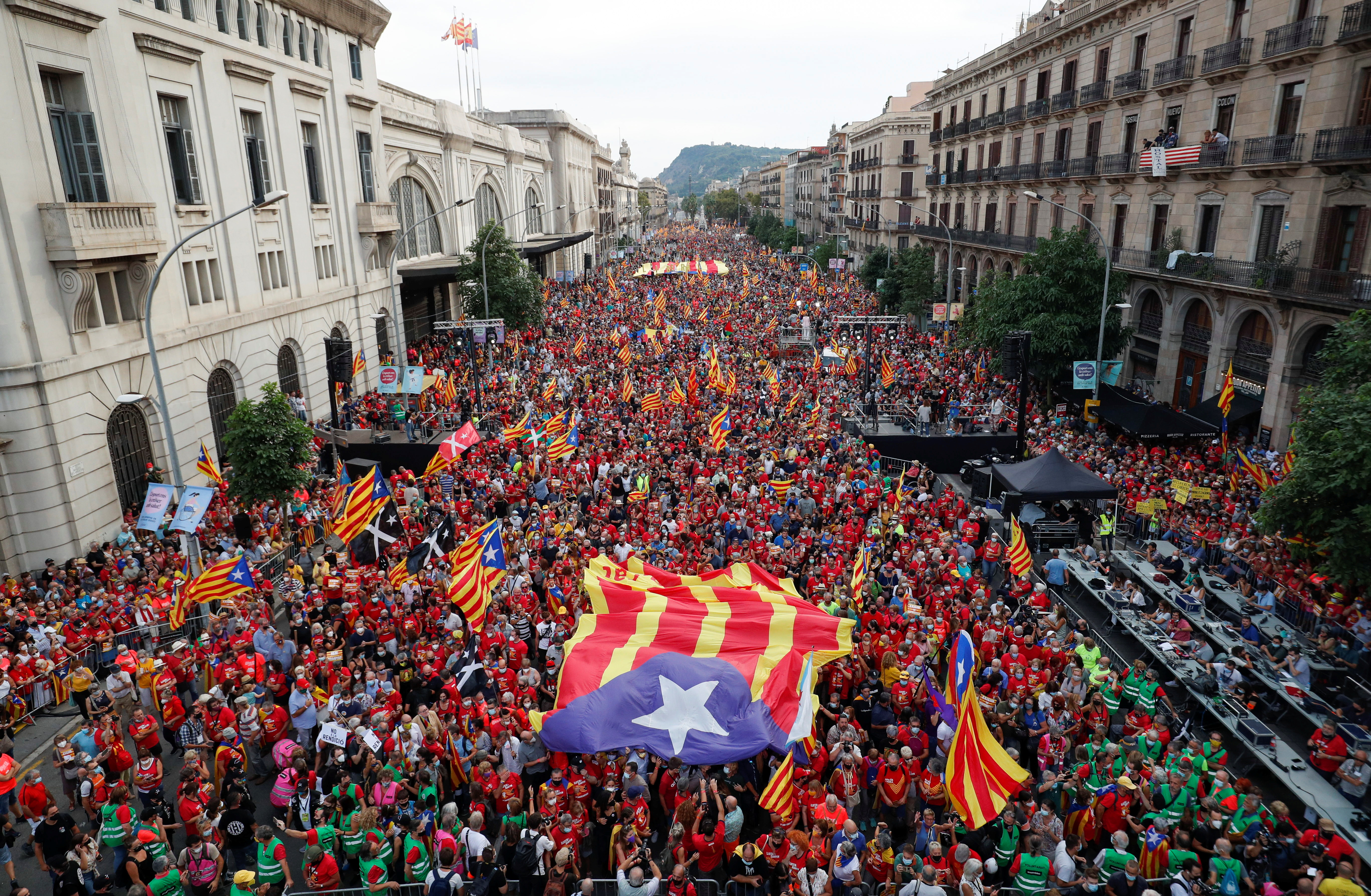 People hold up Esteladas (Catalan separatist flag) during the National Day Catalonia, called 'La Diada', in Barcelona, Spain, September 11, 2021. REUTERS/Albert Gea
