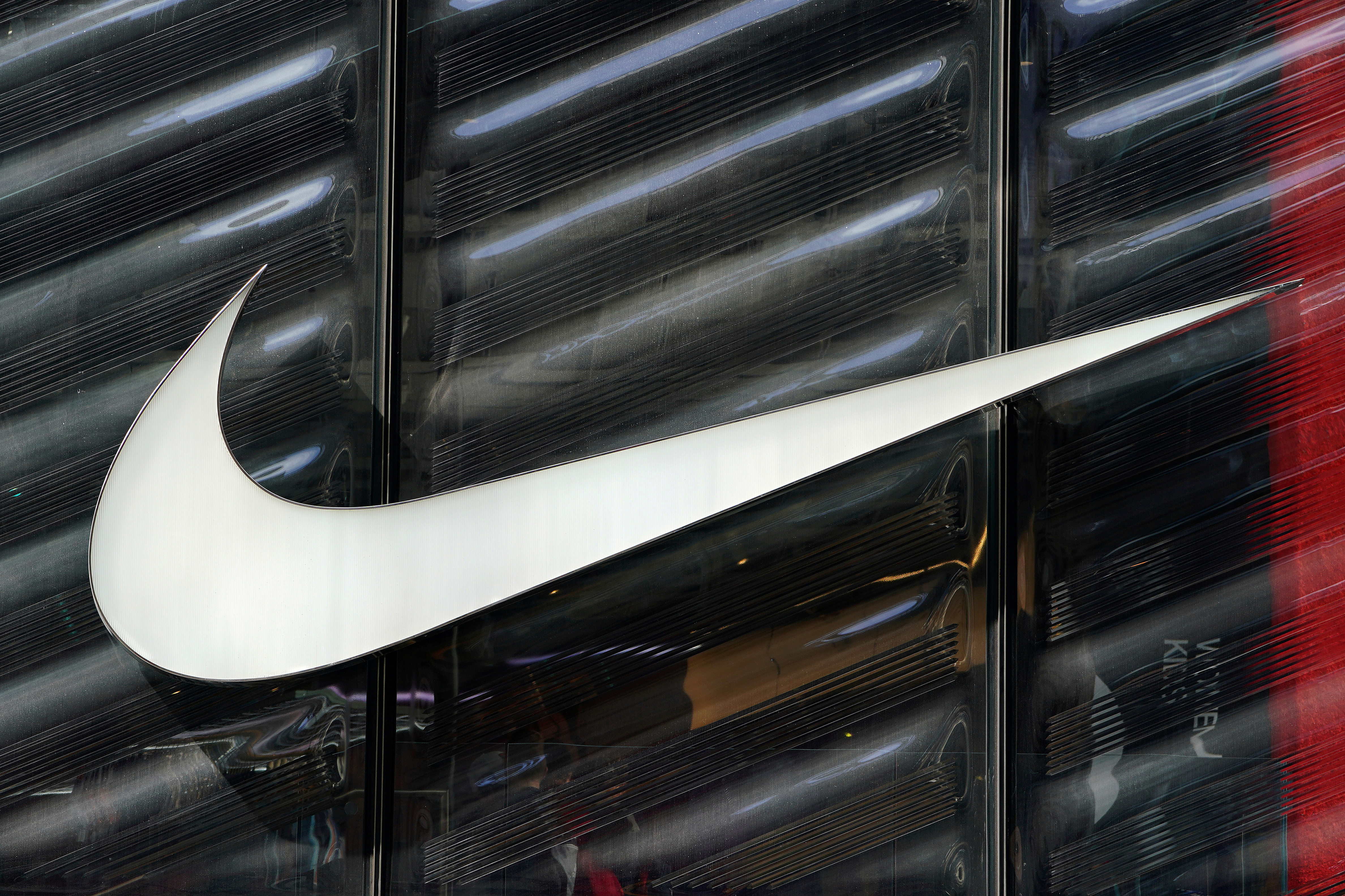 The Nike swoosh logo is seen outside the store on 5th Avenue in New York, New York, U.S., March 19, 2019. REUTERS/Carlo Allegri/File Photo