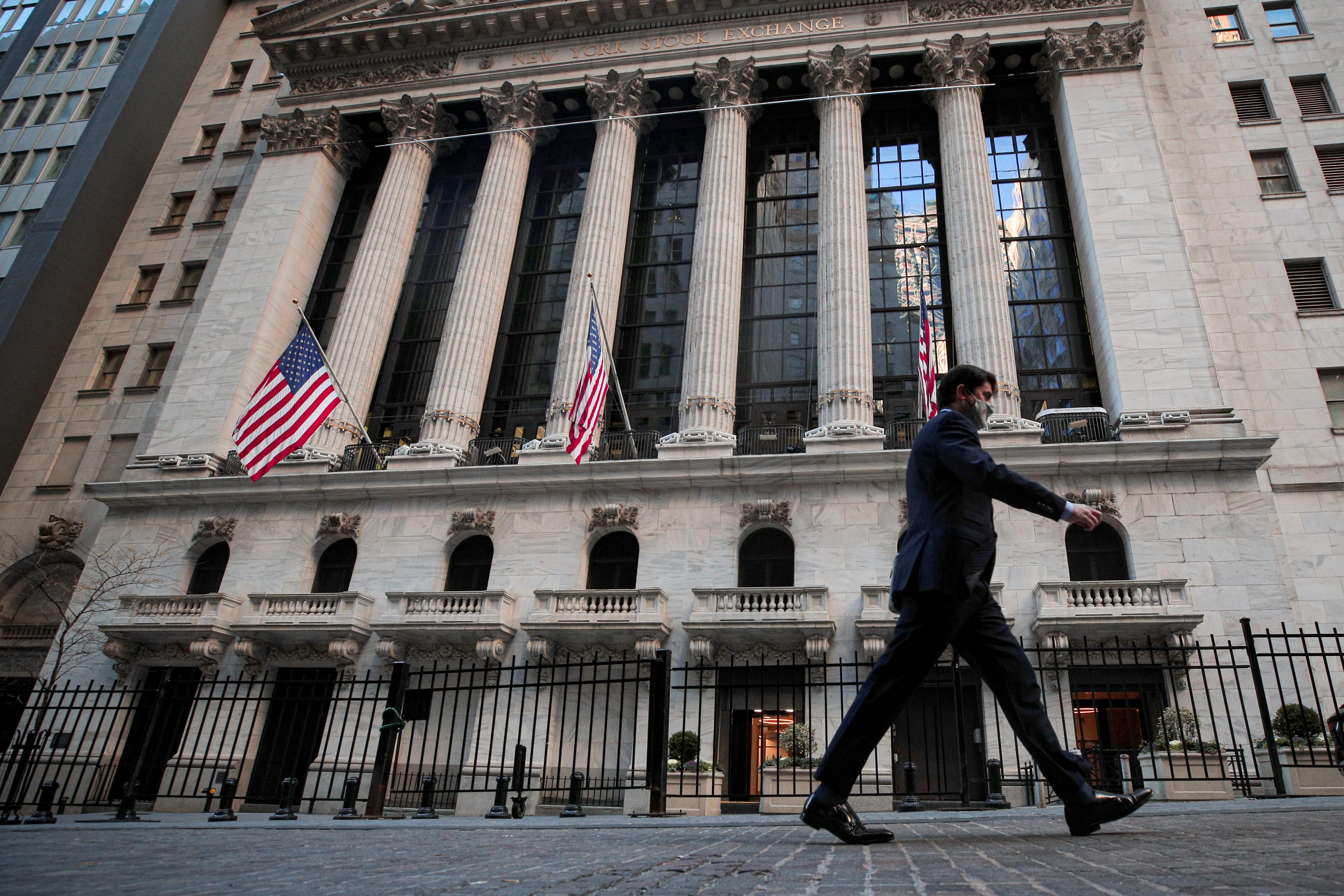 A man walks outside the New York Stock Exchange (NYSE) in New York, U.S., November 24, 2020. REUTERS/Brendan McDermid