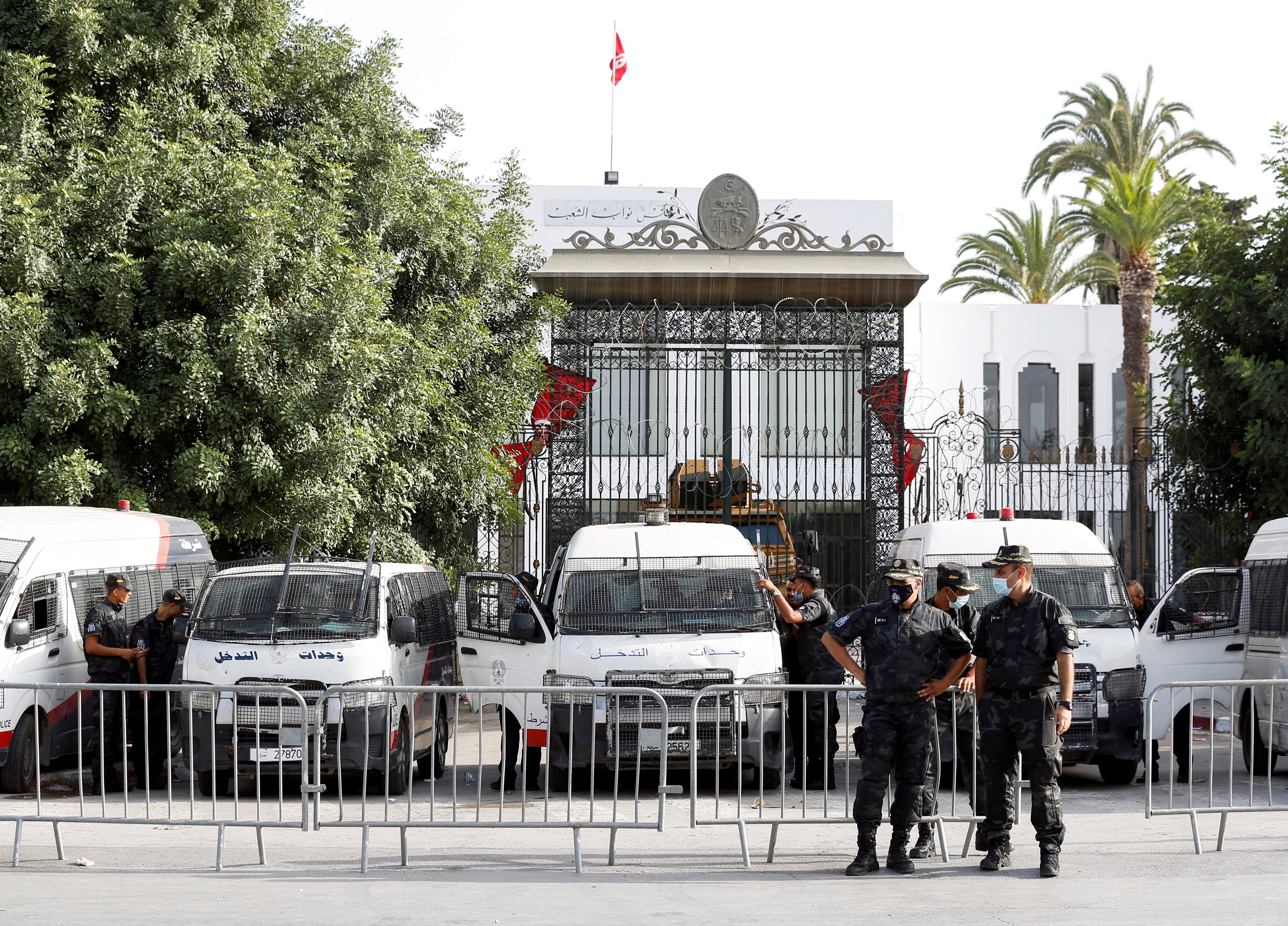 Police officers stand guard outside the parliament building in Tunis, Tunisia  July 27, 2021. REUTERS/Zoubeir Souissi