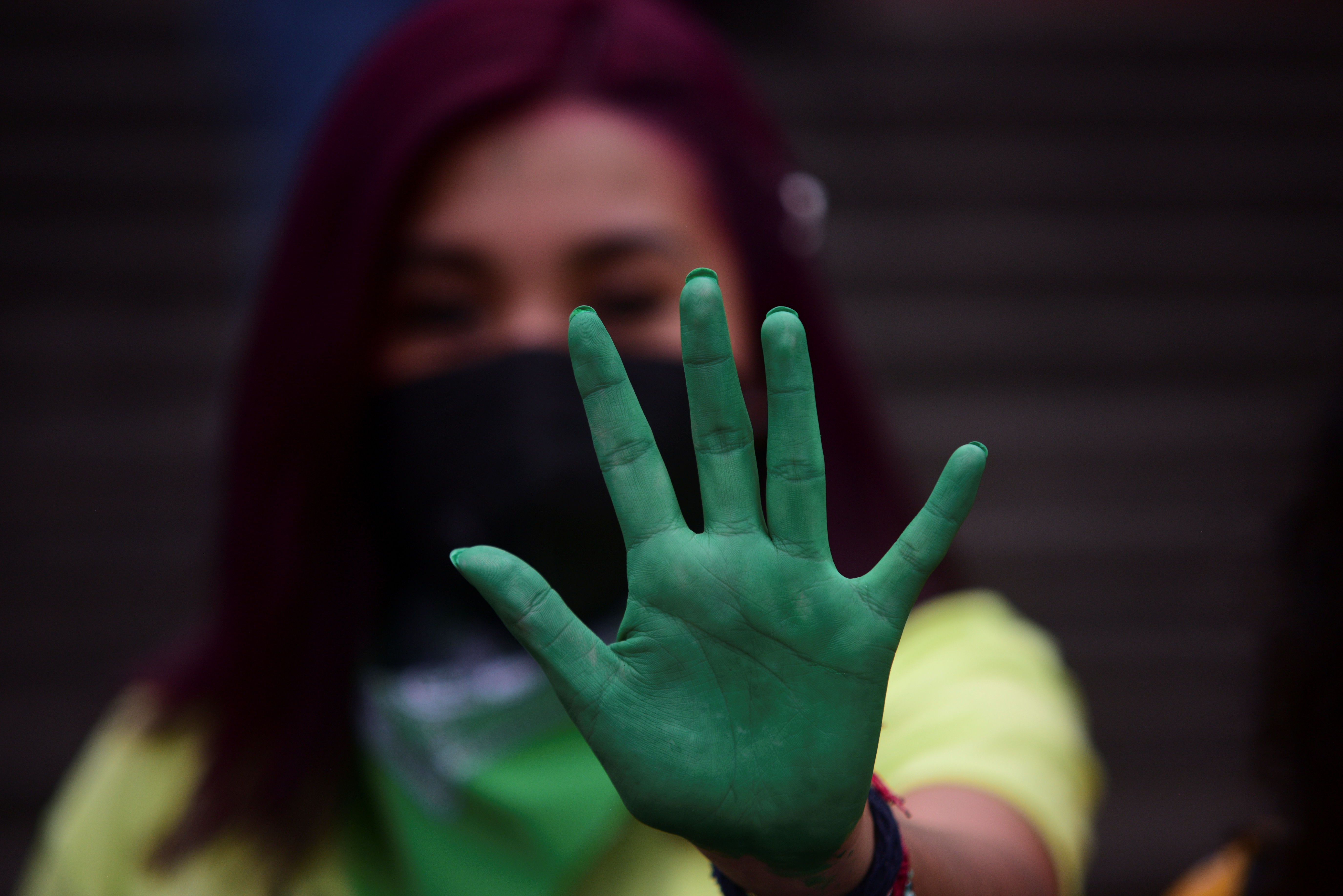 A woman shows her green-tainted palm as she celebrates along other women that Veracruz became the fourth state in Mexico to clear away criminal penalties for elective abortion after lawmakers voted to decriminalize the procedure, at Plaza Lerdo in Xalapa, Mexico July 20, 2021. REUTERS/Oscar Martinez