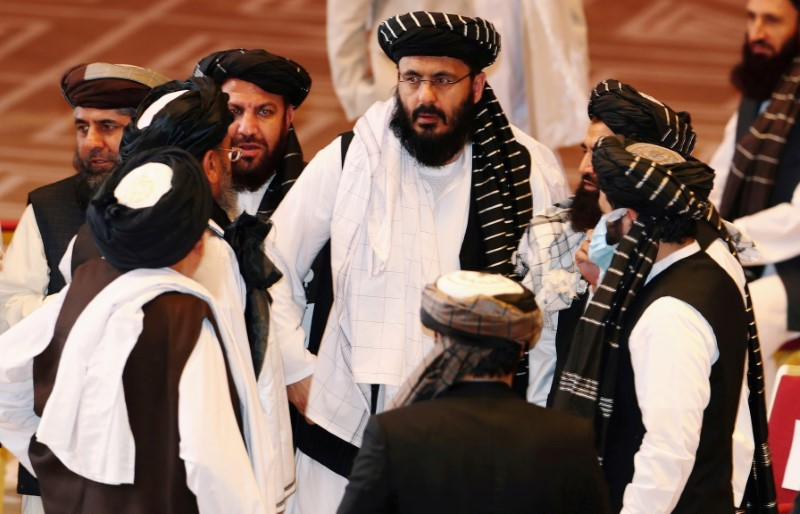 Taliban delegates speak during talks between the Afghan government and Taliban insurgents in Doha, Qatar September 12, 2020. REUTERS/Ibraheem al Omari/File Photo