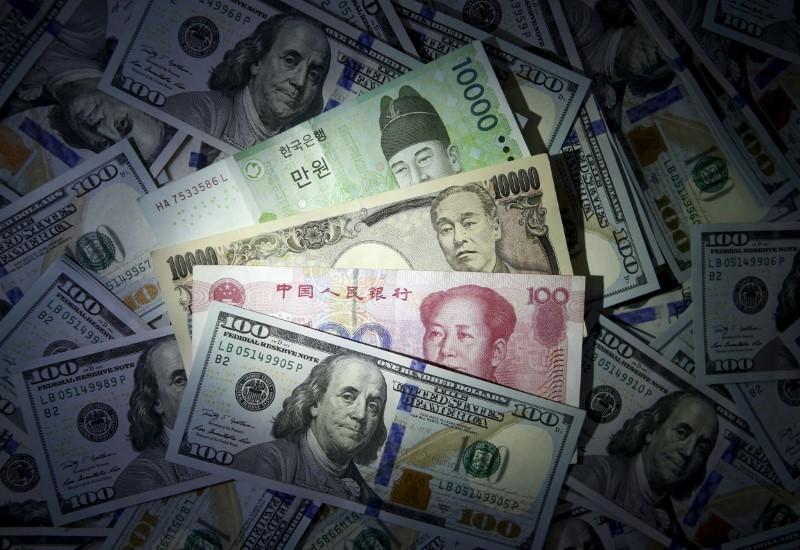 South Korean won, Chinese yuan and Japanese yen notes are seen on U.S. 100 dollar notes in this file photo illustration shot December 15, 2015. REUTERS/Kim Hong-Ji//Illustration/Files