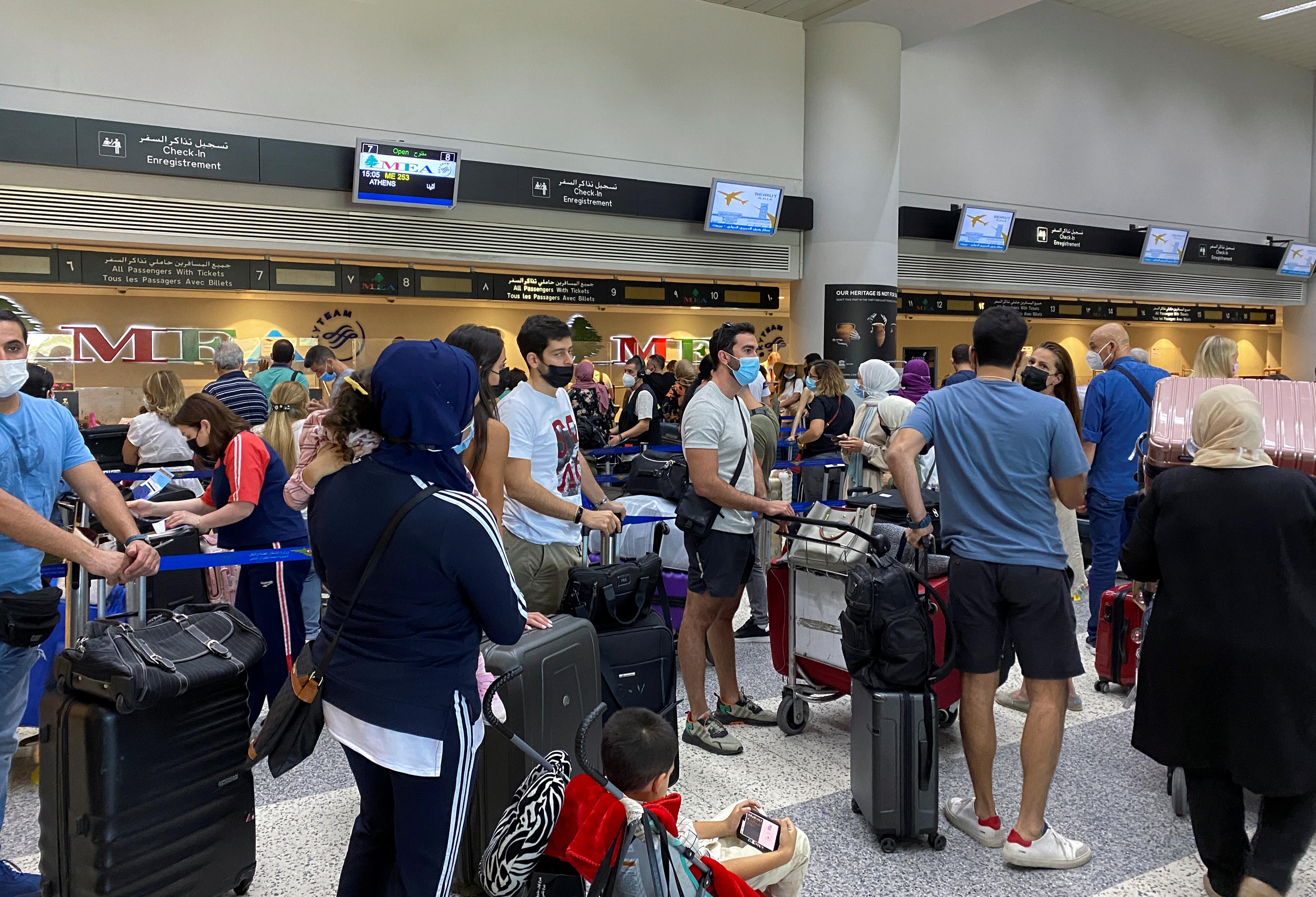 Passengers wait near check-in desks inside Beirut international airport, in Beirut, Lebanon, September 19, 2021. REUTERS/Imad Creidi