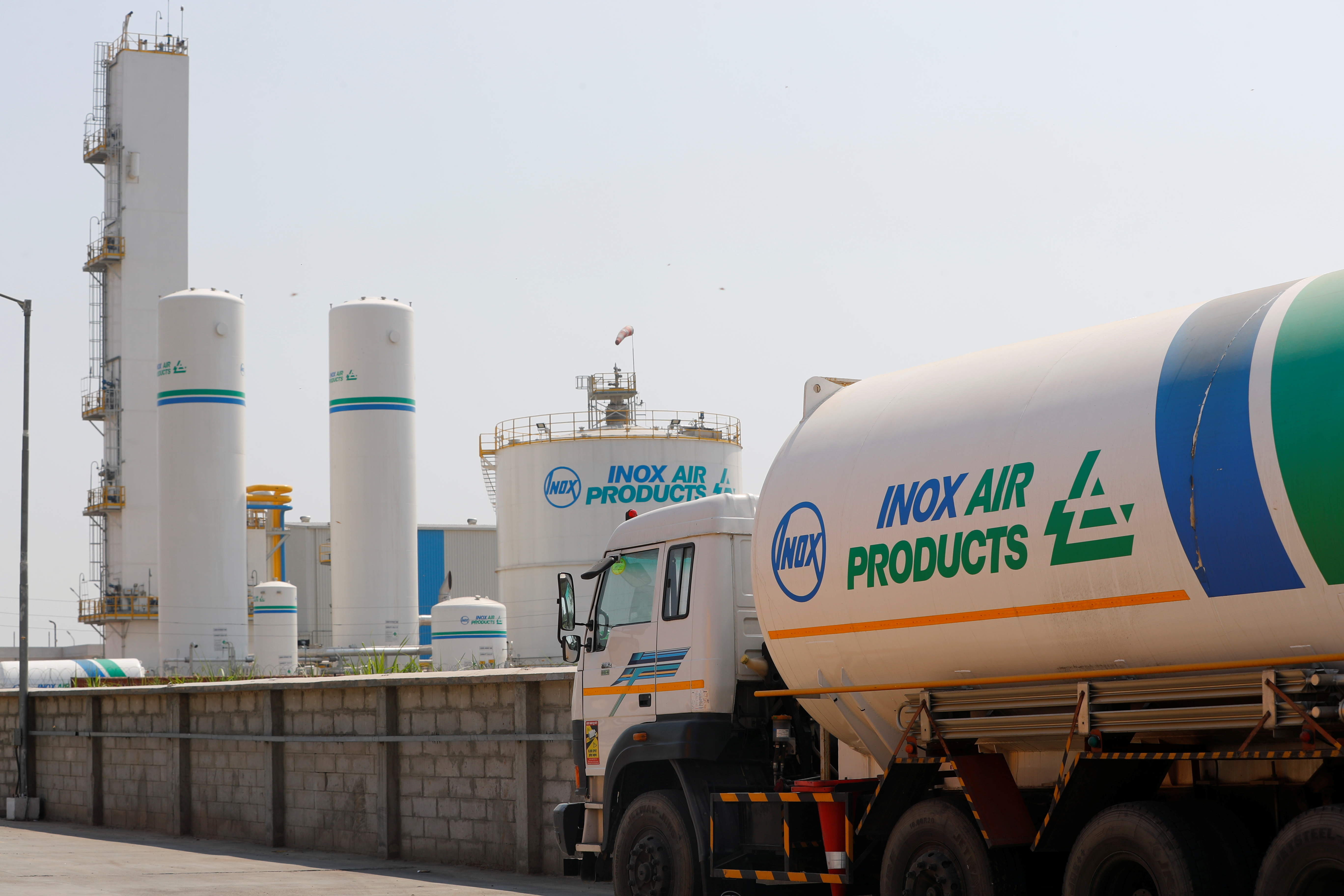 An empty tanker is seen outside an oxygen plant, amidst the spread of the coronavirus disease (COVID-19), in Ghaziabad, on the outskirts of New Delhi, India, April 22, 2021. REUTERS/Adnan Abidi