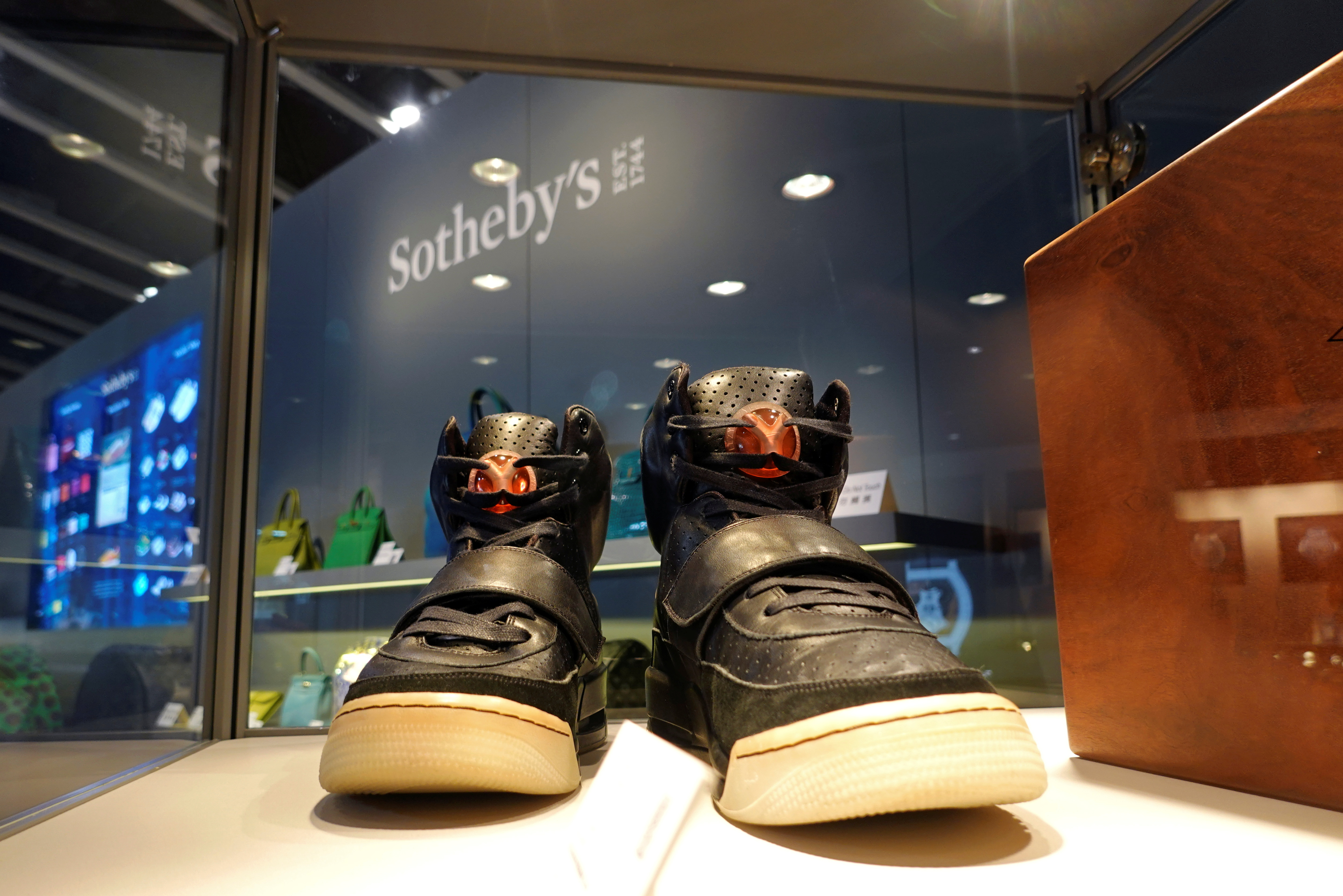 A pair of 'Nike Air Yeezy 1' prototype sneakers designed by Kanye West, are displayed at the Hong Kong Convention and Exhibition Centre before going up for private sale at Sotheby's, in Hong Kong, China April 16, 2021. REUTERS/Joyce Zhou