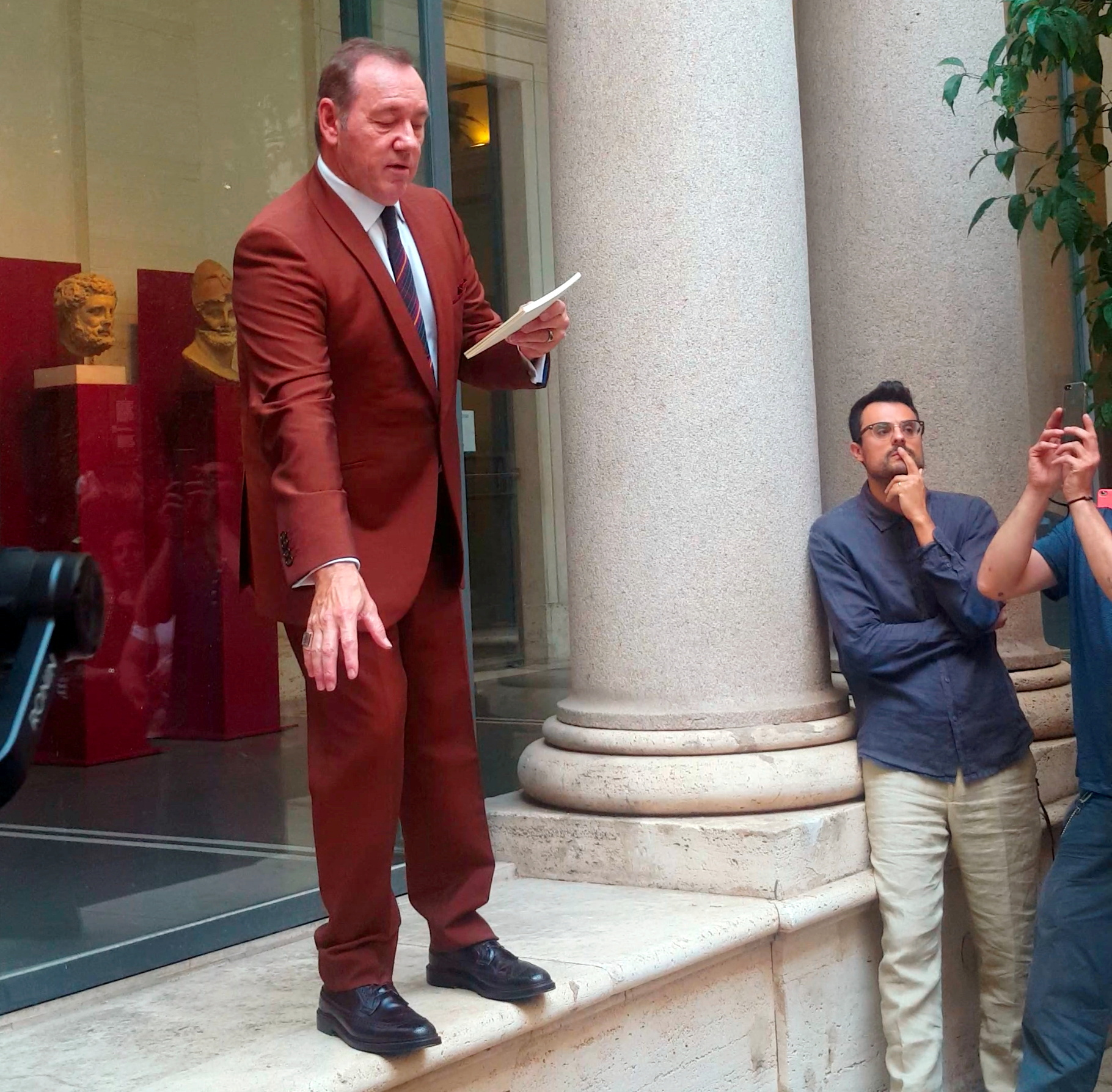 Actor Kevin Spacey reads a poem in front of the public in the courtyard of the Museo Nazionale Romano Palazzo Massimo in Rome, Italy August 3, 2019 in this still image taken from social media video. Antonia Falcone via REUTERS