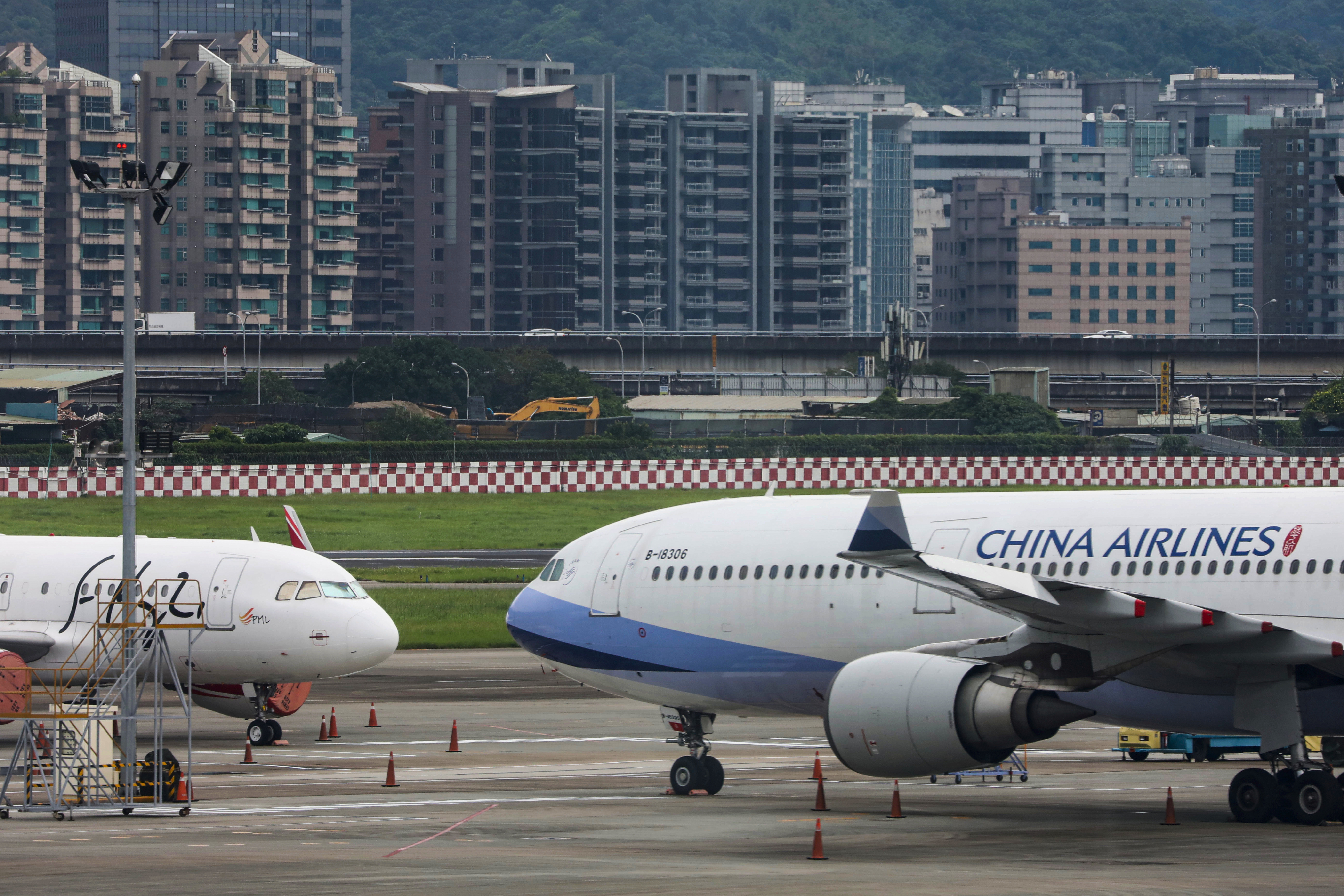 Passenger jets of Taiwan's China Airlines at Taipei Songshan Airport in Taipei, Taiwan, June 8, 2020.REUTERS/Ann Wang