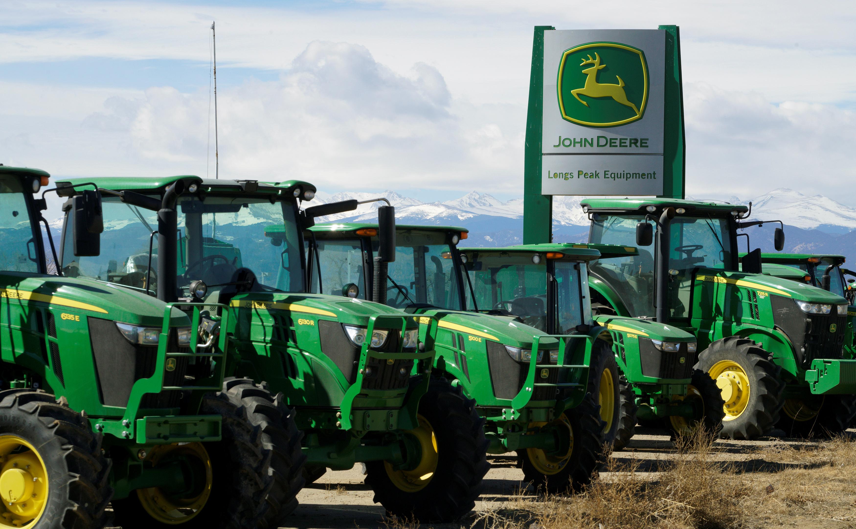 John Deere tractors are seen for sale at a dealer in Longmont, Colorado. REUTERS/Rick Wilking