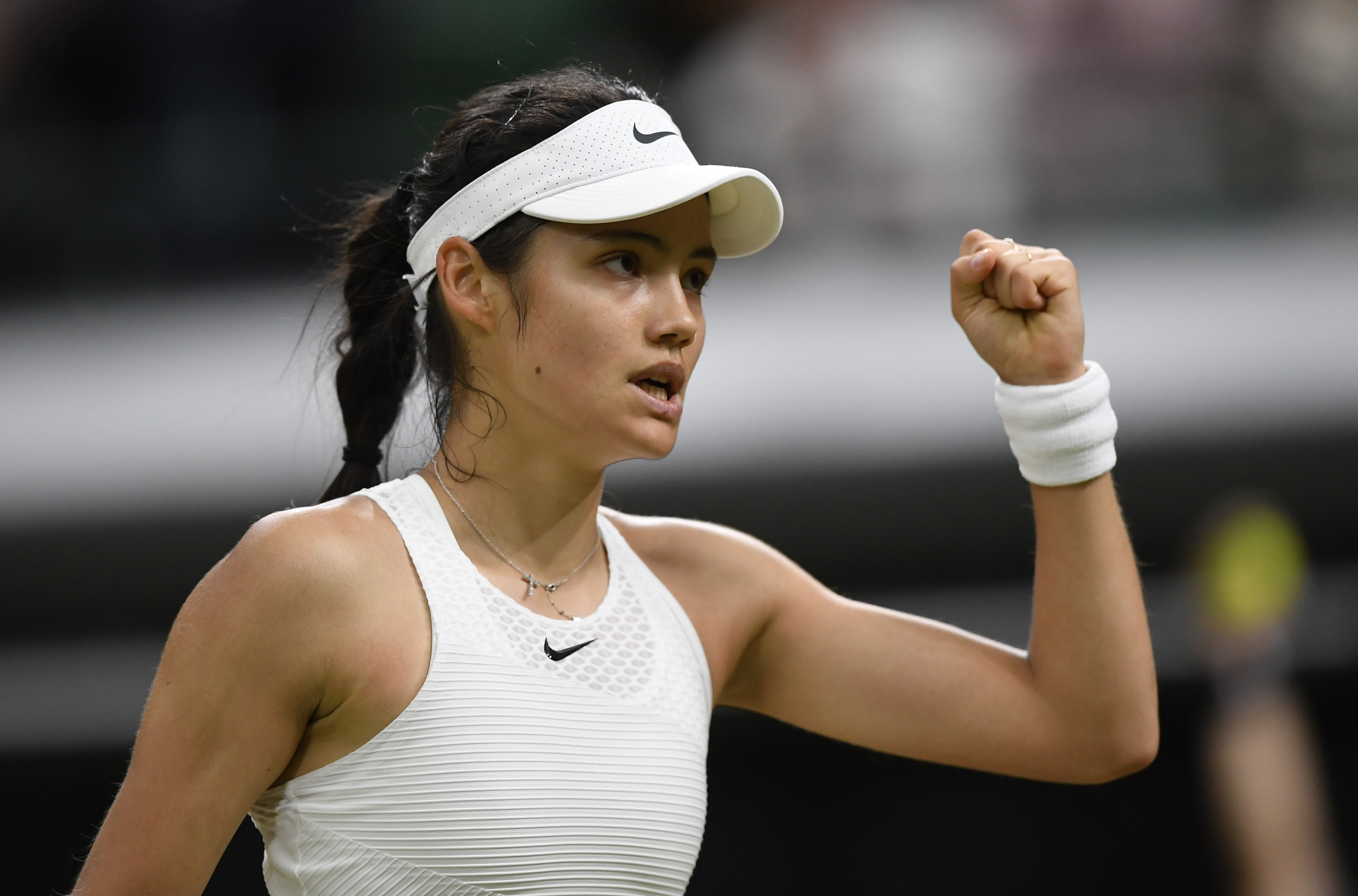 Tennis - Wimbledon - All England Lawn Tennis and Croquet Club, London, Britain - July 5, 2021 Britain's Emma Raducanu reacts during her fourth round match against Australia's Ajla Tomljanovic REUTERS/Toby Melville