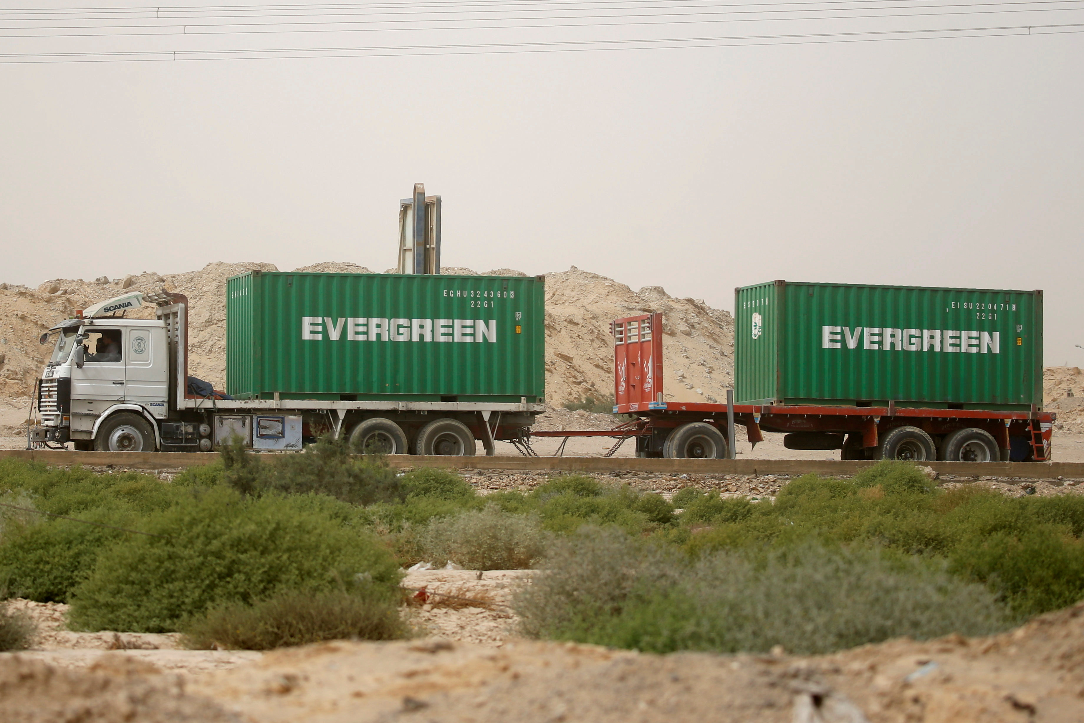 A truck carrying Evergreen containers, waits to pass through the main gate of the El Ain El Sokhna port to Suez Canal, Egypt March 24, 2021. REUTERS/Amr Abdallah Dalsh