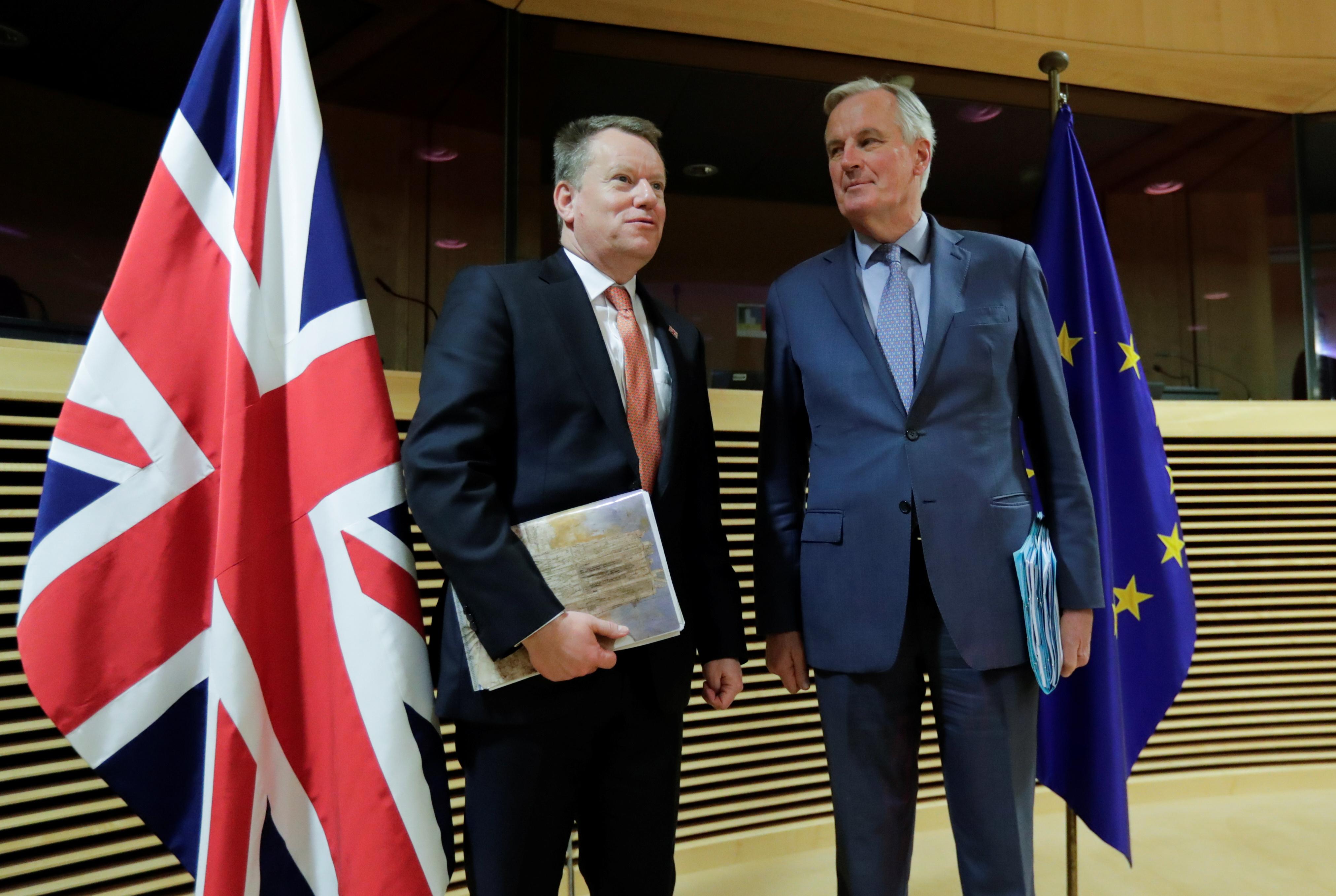 European Union chief Brexit negotiator Michel Barnier and British Prime Minister's Europe adviser David Frost 5 are seen at start of the first round of post -Brexit trade deal talks between the EU and the United Kingdom, in Brussels, Belgium March 2, 2020. Oliver Hoslet/Pool via REUTERS